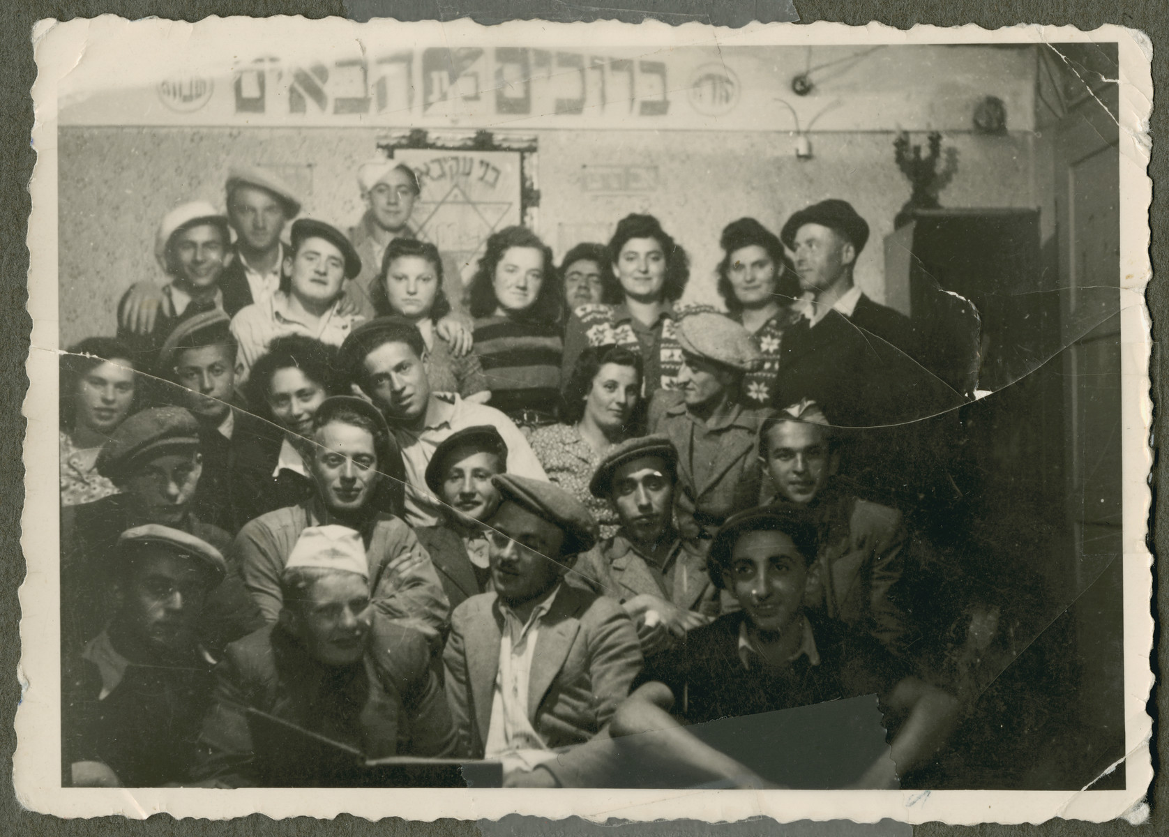 Group portrait of members of the Bnai Akiva kibbutz in Foehrenwald.  Among those pictured is Peretz Feder, standing in the back on the far right.