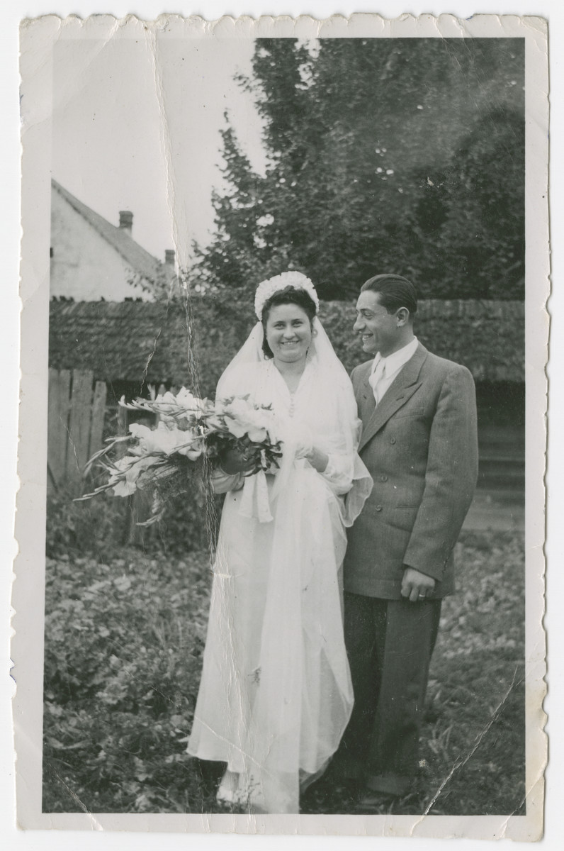 Portrait of the first Jewish couple to wed in Mukachevo after the war.    Pictured are Rivscu Weiss and her husband.