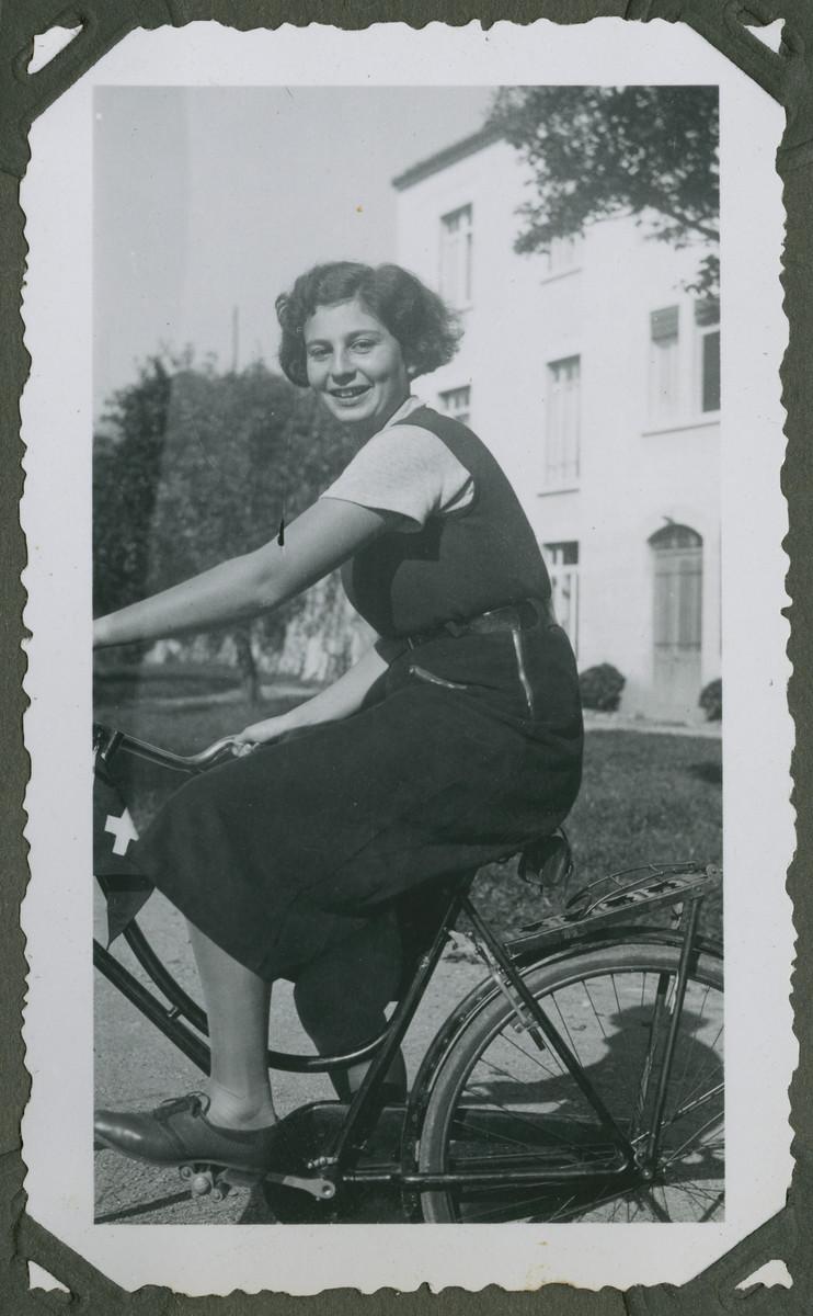 Miriam Wheeler, a cousin of Anita Lamm, rides a bicycle..