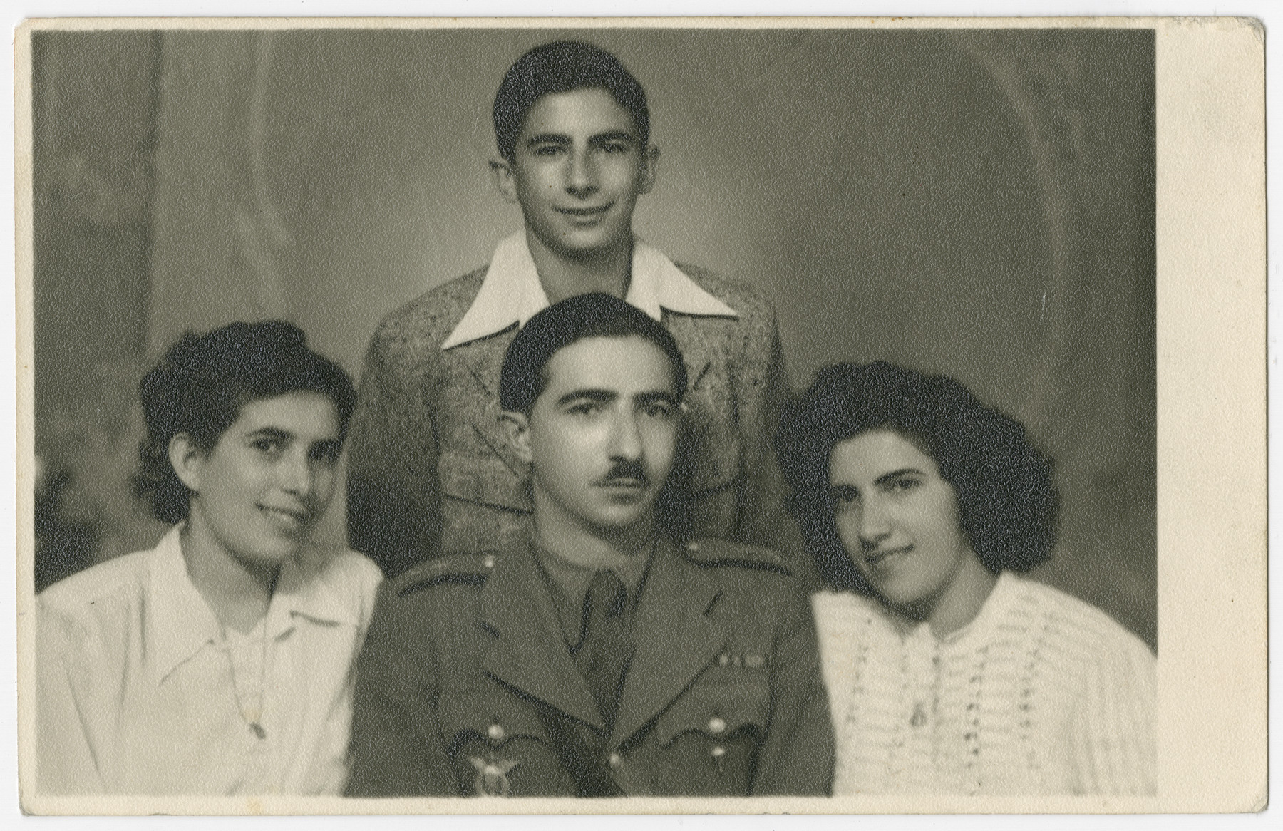 Postwar portrait of the surviving Smilovic siblings.  Sitting from left to right are Rivsvu, Isak Leib and Heddy.  Sziku is standing behind them.