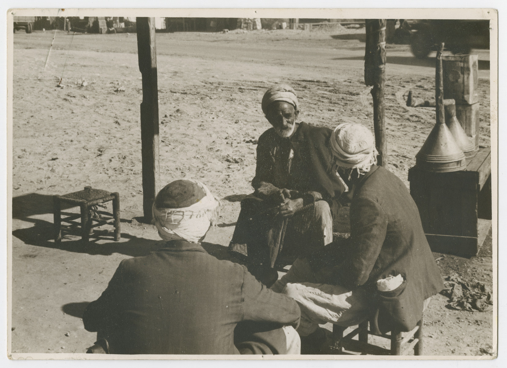 "[Sephardic Jews, possibly Yemenites] sit outside and socialize.  Photograph is used on page 249 of Robert Gessner's ""Some of My Best Friends are Jews."""