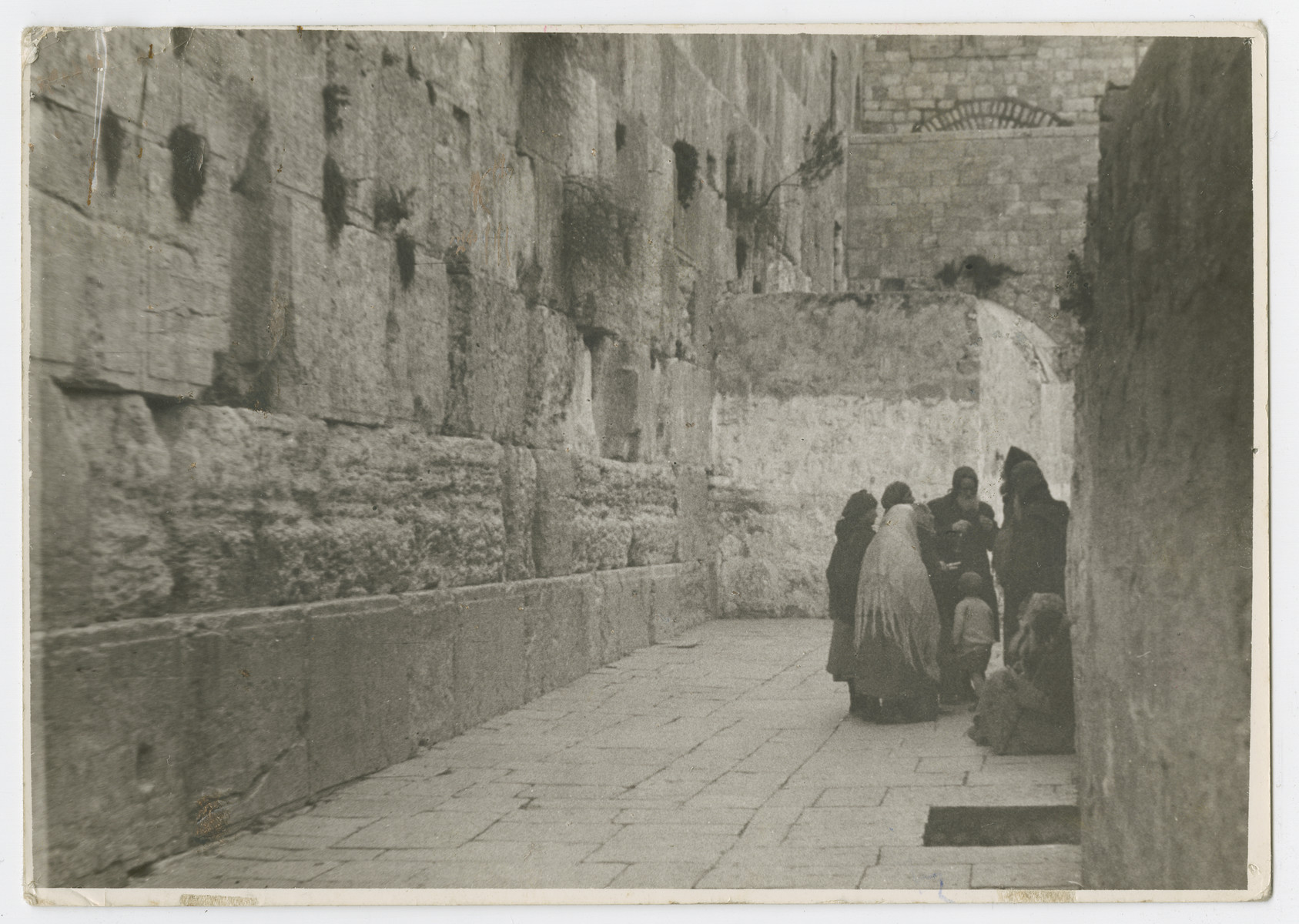 "A photo of aged Sephardic Jews at the Wailing [Western] Wall.   Photograph is used on page 279 of Robert Gessner's ""Some of My Best Friends are Jews.""  The typed caption attached to the photograph reads, ""Aged Sephardic Jews at the Wailing Wall."""