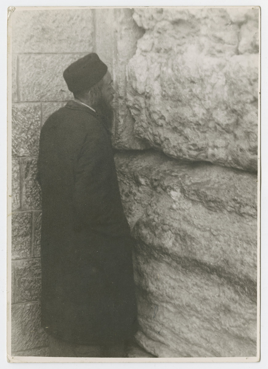 """A Jewish man prays at the Wailing [Western] Wall.  Photograph is used on page 279 of Robert Gessner's """"Some of My Best Friends are Jews."""""""