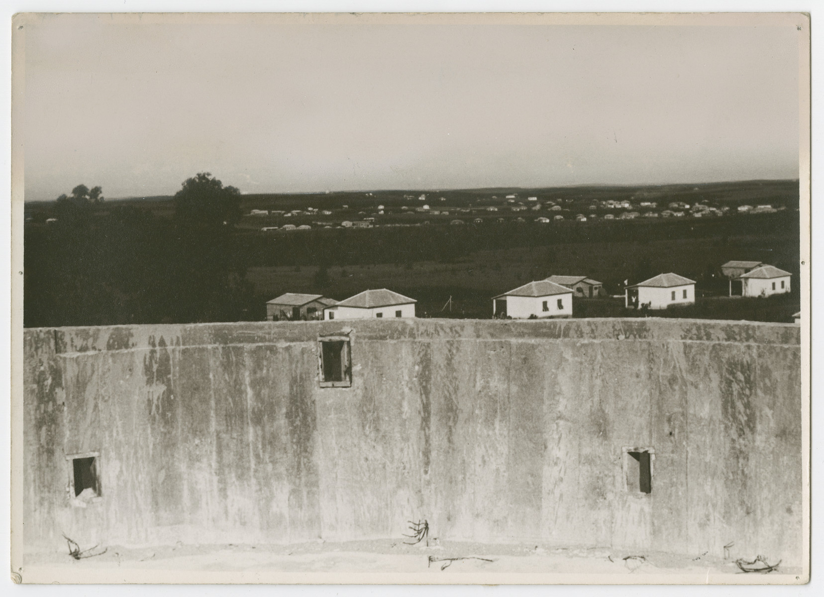 "View of a water well in front of a Jewish settlement, probably in the Galilee.  Photograph is used on page 195 of Robert Gessner's ""Some of My Best Friends are Jews."" The pencil inscription on the back of the photograph reads, ""Water wall with gun port holes as protection ag Arb."""
