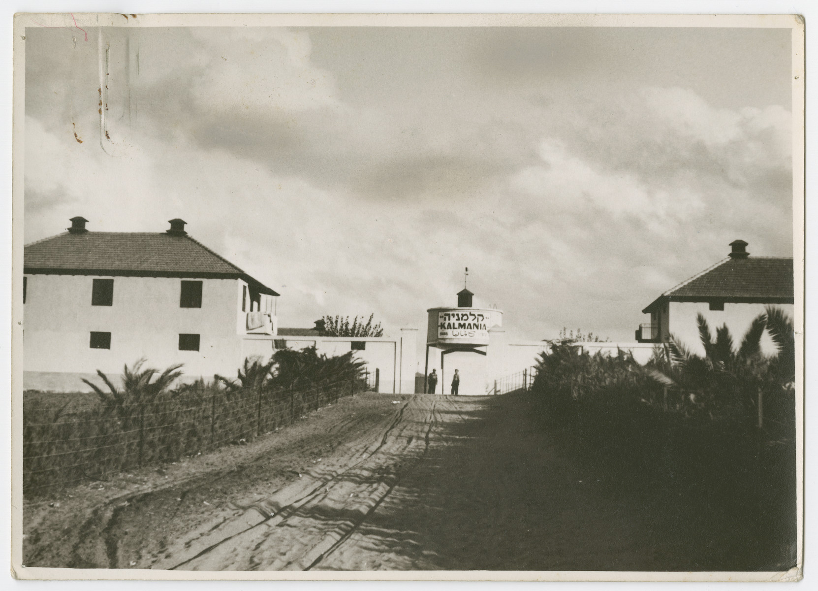 "View of the Jewish settlement of Kalmania.  Photograph is used on page 240 of Robert Gessner's ""Some of My Best Friends are Jews."" The pencil inscription on the back of the photograph reads, ""Homes built as Forts as protection."""