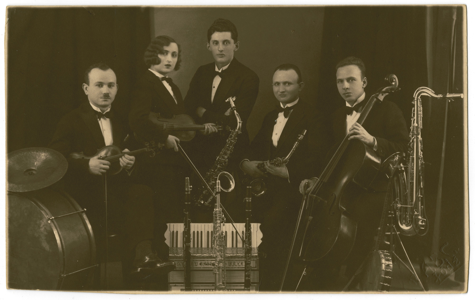 Portrait of a small band in prewar Lodz, Poland.  Avrum Feder (a cousin of the donor's grandmother who peished in the Holocaust) is pictured in the center.  Maurice Bergen (grandfather of the donor) is on the far right.