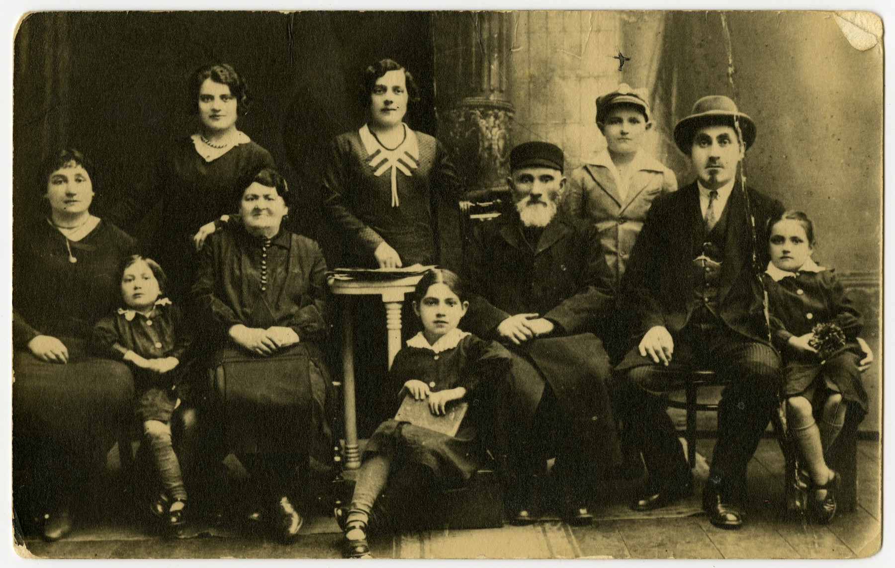 Prewar studio portrait of the Sadik and Opalka family.  From let to right are seated: Ruchel Kala (nee Opalka) Sadik, Rivke Sadik, Esther Opalka, Golda Sadik, Abraham Opalka, Yosef Sadik and Rivke Sadik.  Standing are Gittel Opalka, Fradel Opalka and Nachman Mendel Sadik.