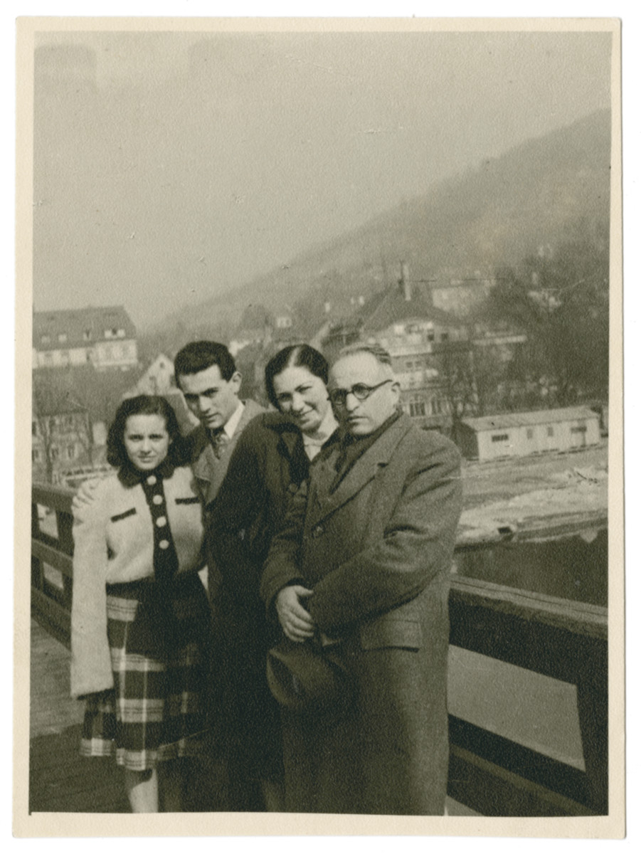 The Ornstein family poses on a bridge in Heidelberg.  Pictured from left to right are Anna and Paul Ornstein, Luisa Schwarzwald-Hornstein and Lajos Ornstein.