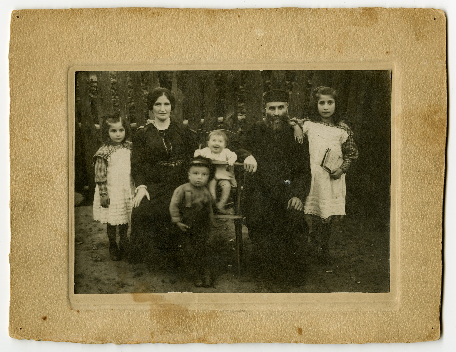 Moshe and Krjndel Mirla family pose in their garden with three of their children.  Miriam Mirla is pictured on the far right.