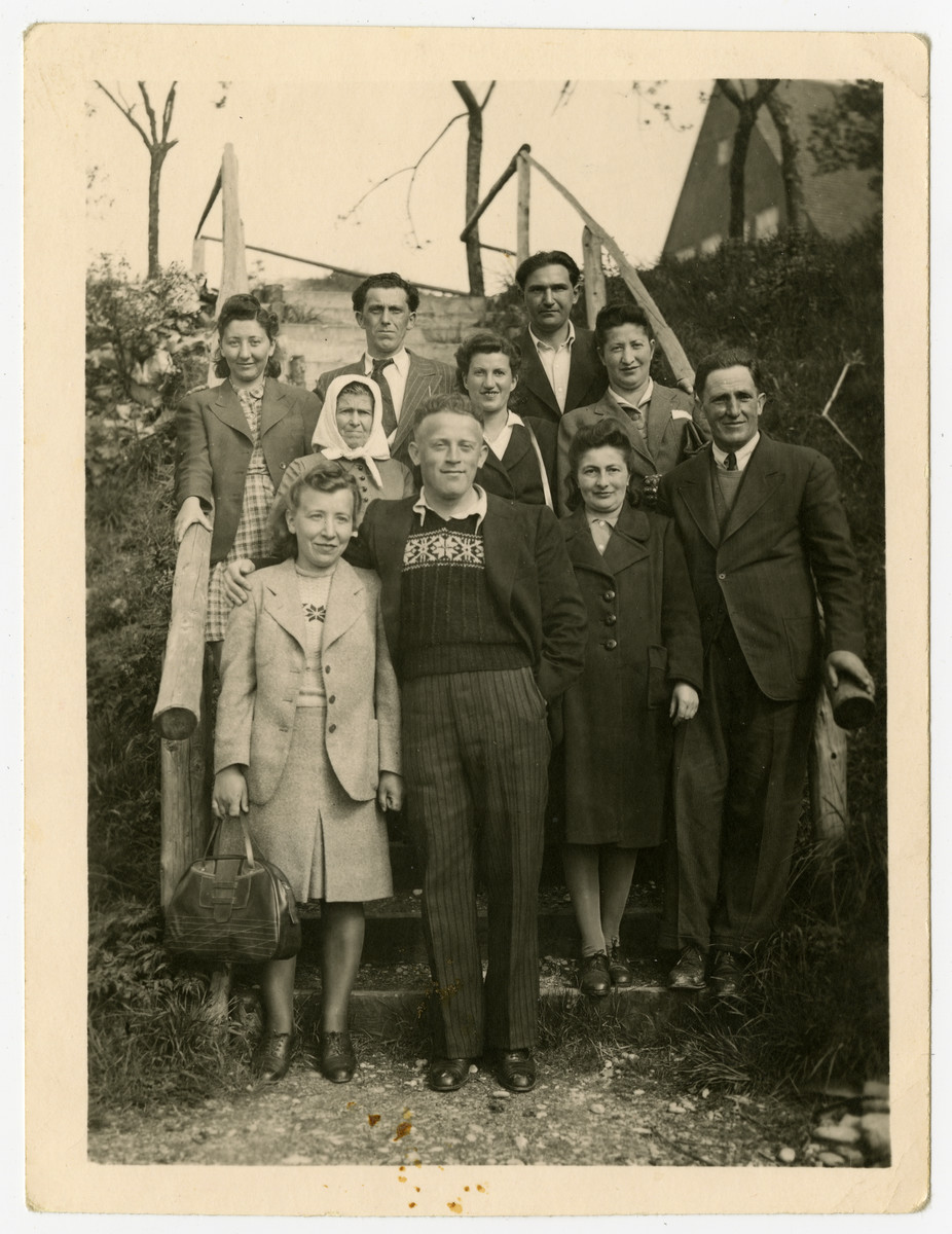Group portrait of Jewish displaced persons in either Steyr or Braunau.  Among those pictured are Nachman and Miriam Sadik (upper right) and Miriam's cousin.Czarna Kulas Zimmer (second row, second from the right).
