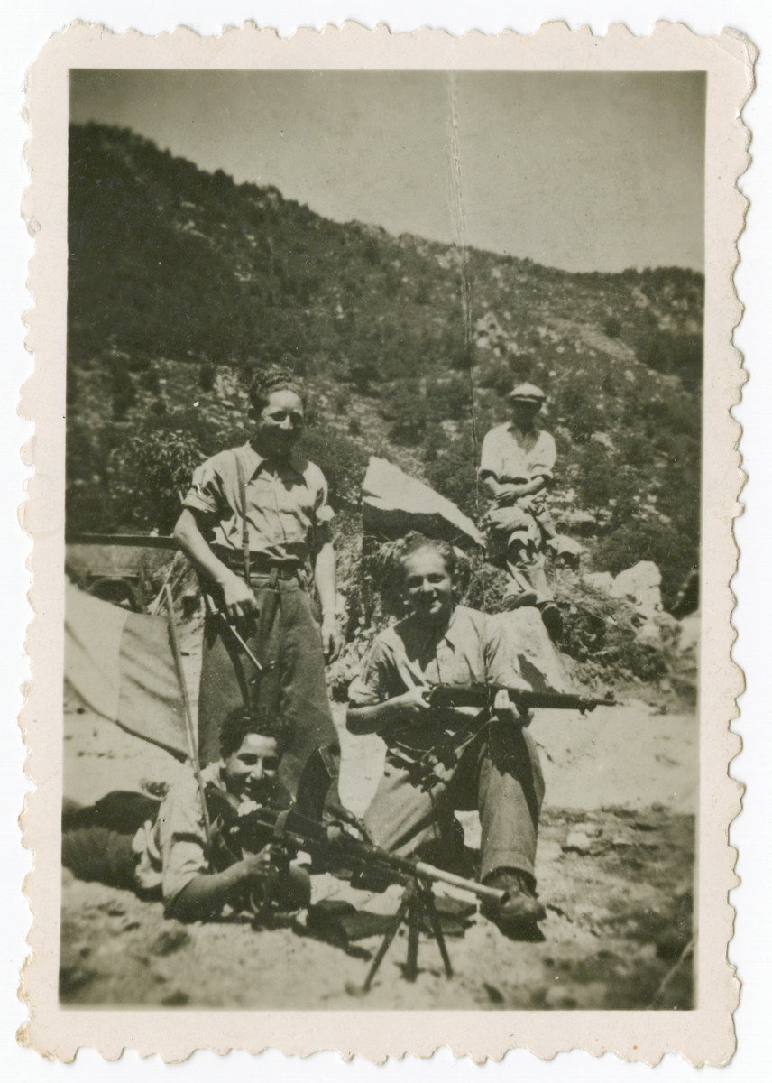 Members of the 108th company of the F.T.P.F. (Francs-tireurs et partisans français), the communst resistance group pose with their weapons at a mountain base.  Among those pictured is Claude Lowenstein (lying down at lower left).