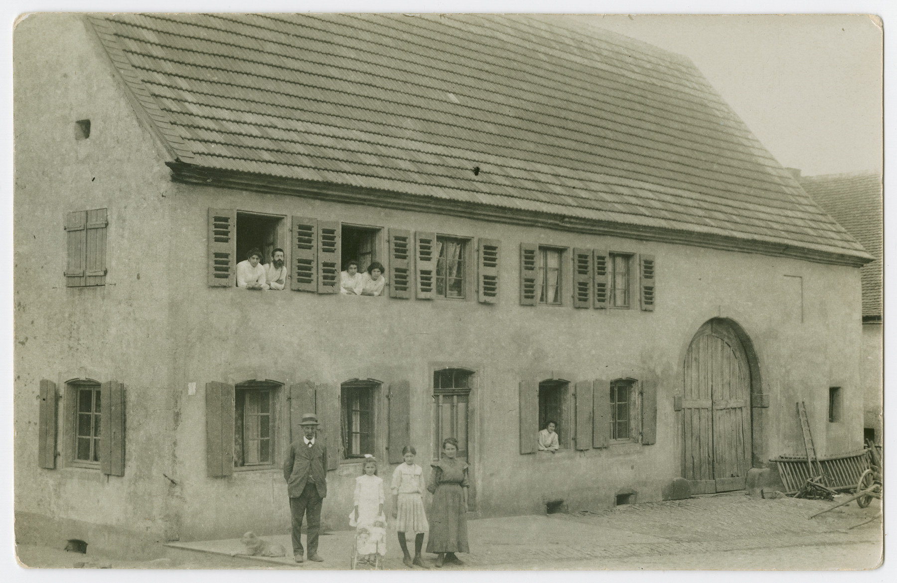 Erna Isenberg (nee Marx), far right in second floor window, poses with extended maternal relatives.    Pictured (L-R) on upper story are Settchen Schott (nee Salomon), Karl Schott, Amalie Salomon, and Erna Marx.  Salomon Salomon, Klara Salomon, Elfriede Schott, Charlotte Salomon and an unidentified woman appear standing (L-R) and in a lower story window.