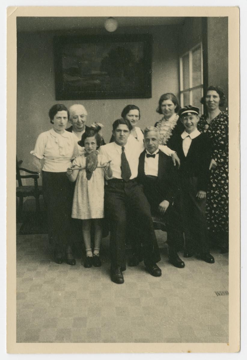 A German-Jewish family residing in Liechtenstein pose for a photograph.  Pictured (L-R): Bertha Greif, Bertha Marx, Margot Greif, Helmut Isenberg, Jetta Suesskind, Leo Greif, Erna Isenberg, Norbert Isenberg, and Alice Marx.
