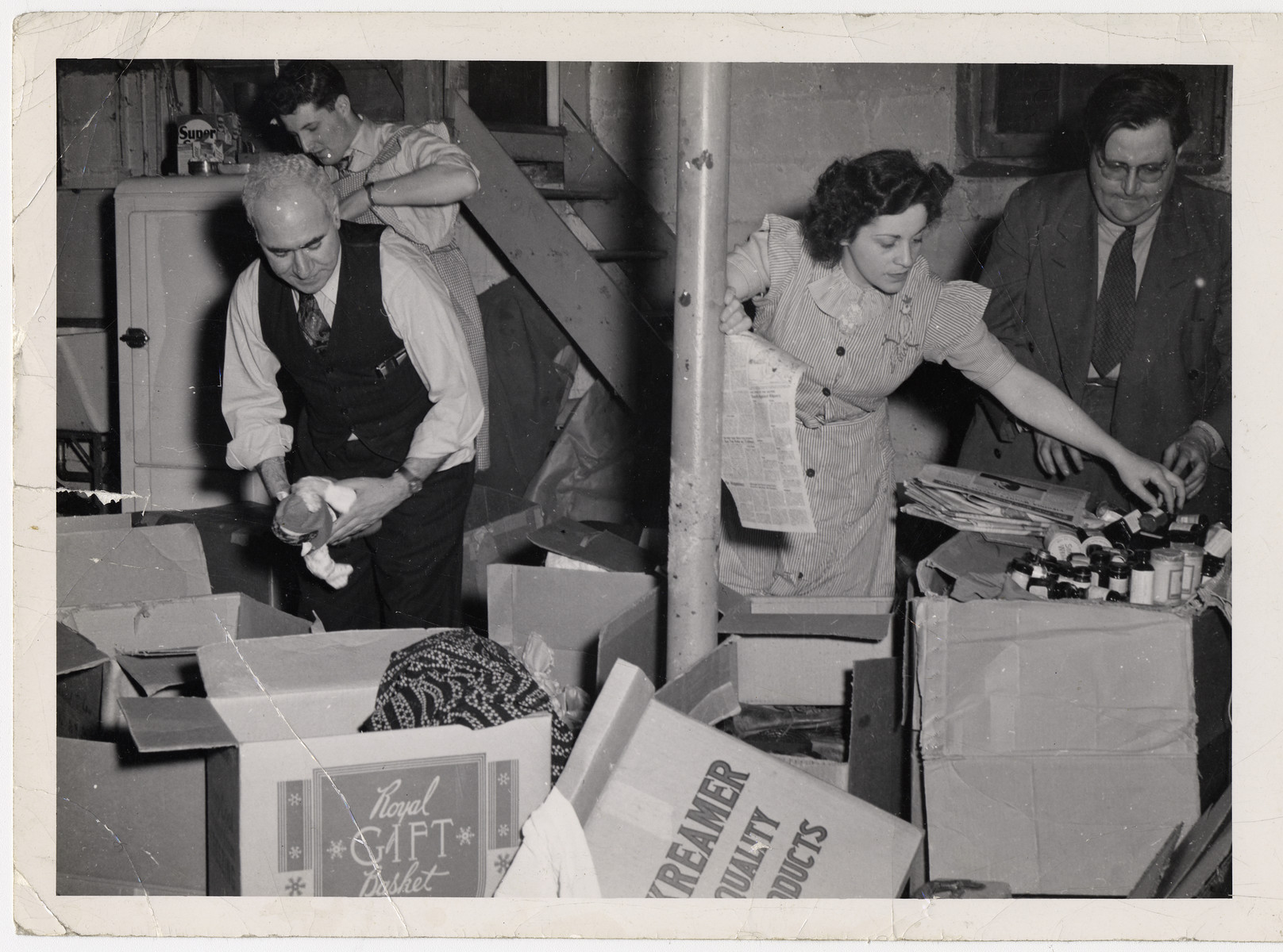 Maurice Levitt (front left) and three other members of the Frankfurt Jewish GI Council unpack boxes of supplies sent by the American Jewish community to aid displaced persons.