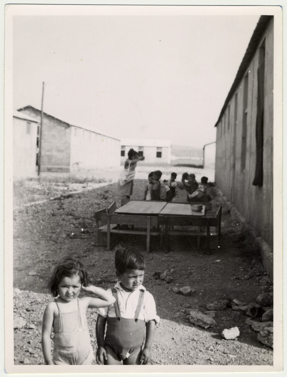 "Young children study outside in the kindergarten of the  Rivesaltes internment camp.  Original caption reads: ""School in the out doors."""