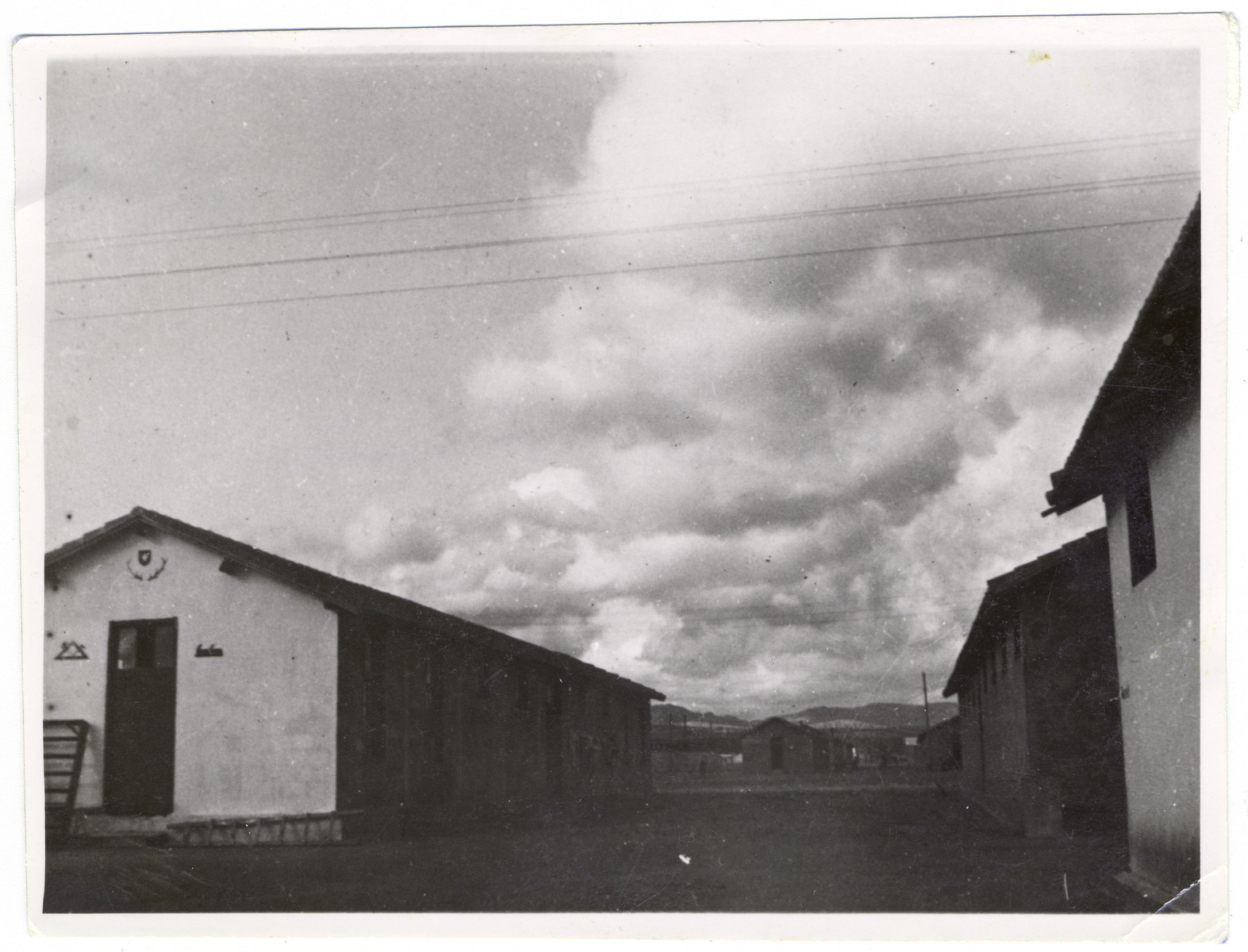 """View of the barracks of the Rivesaltes internment camp.   Original caption reads: """"A view of Rivesaltes."""""""