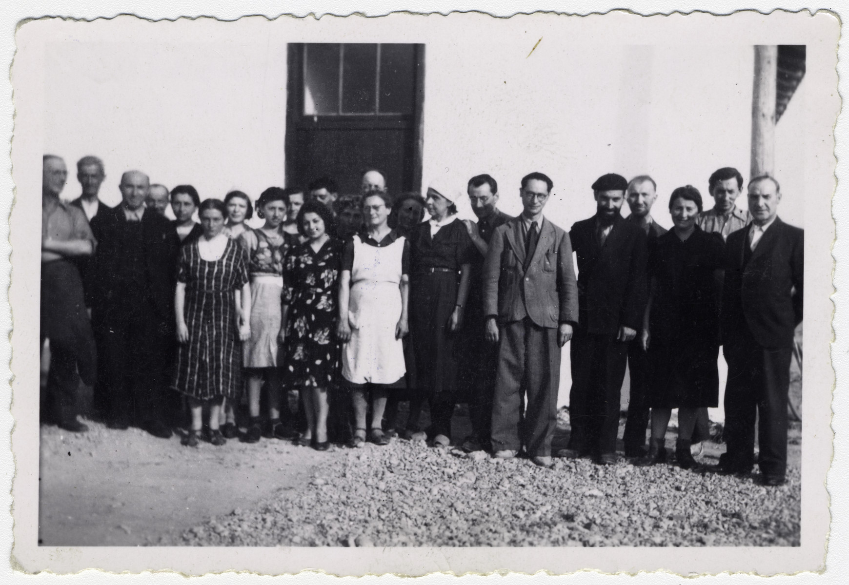 "A group of Jewish men and women pose at the Rivesaltes internment camp.   Original caption reads: ""The Charity Committee for the interned Jews. (all internees).""    Among those pictured is Rabbi Jacob Bloch (fifth from the right) and Erwin Heilbronner (fourth from the right). These are probably the members of CLIO (Le Comite d'liaison israelite du oeuvres), the Jewish liaison committee."