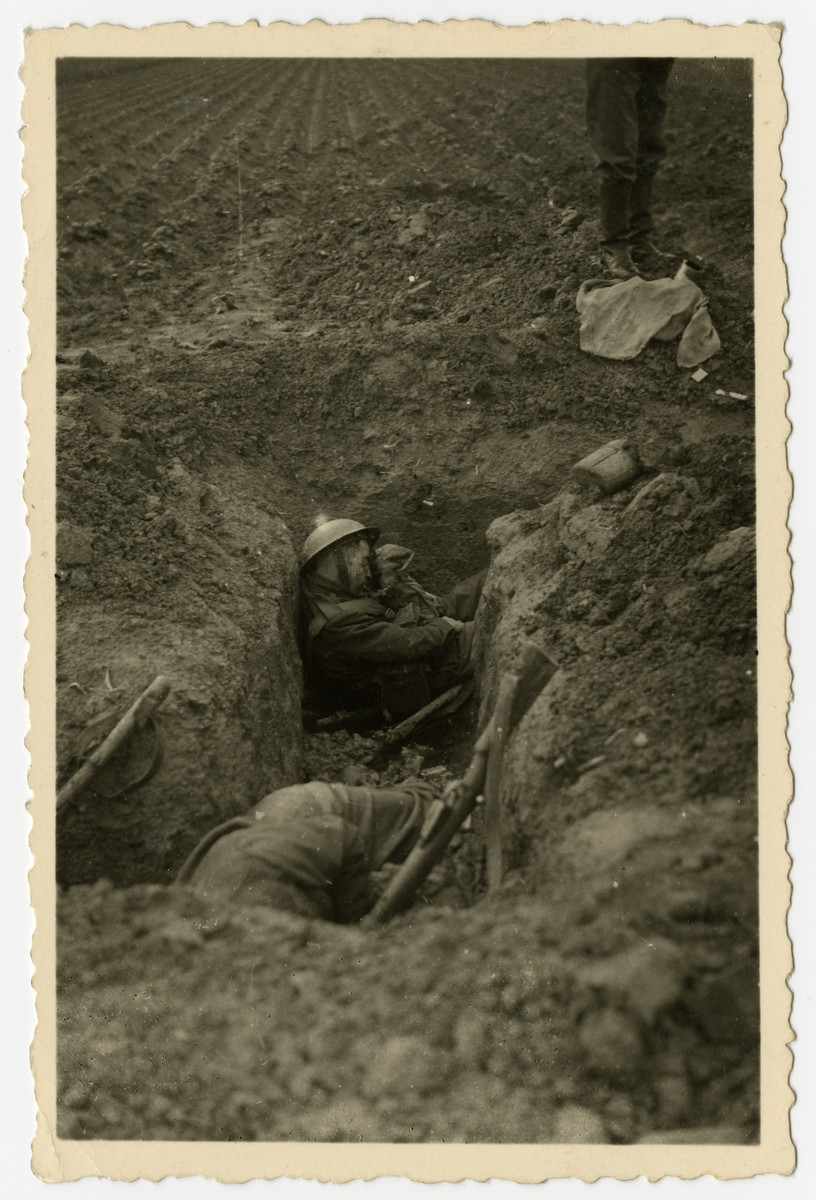 The corpses of British soldiers lie in trenches near the Bassee Canal prior to the retreat to Dunkirk.