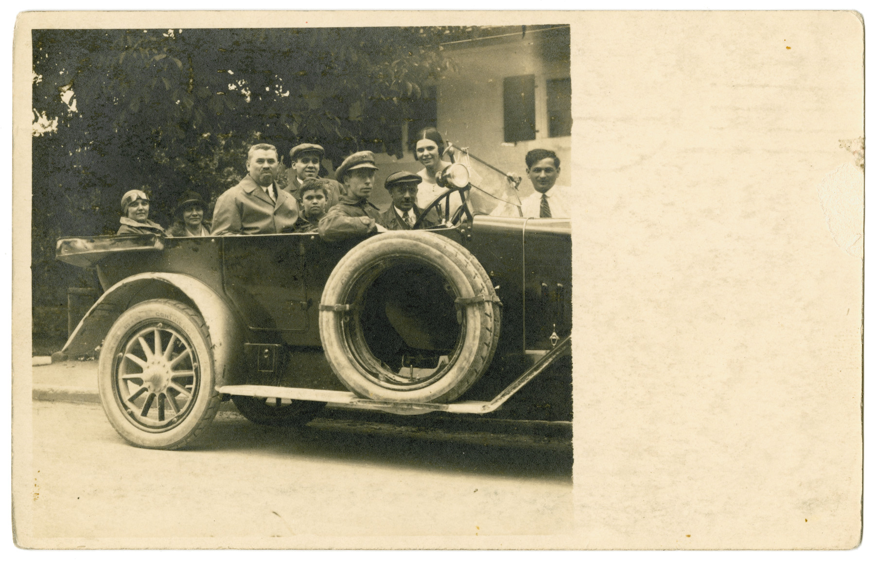 The Landman family goes for a car ride in its first automobile.