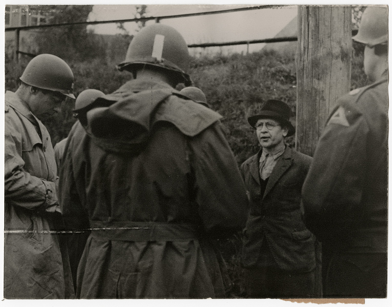 A German spy says his last words before his execution.  Original caption reads:  Nazi Spy Shot After Military Trial Richard Jarczyk, Nazi soldier, who became a spy in civilian clothes, was executed April 23, 1945, after court trial by a military commission of the Seventh U.S. Army. After he had discarded his uniform, Jarczyk, former member of the Volks Grenadier Division, approached U.S. Army officials and offered his services in establishing a civilian government in an occupied area of the Reich. U. S. Military authorities discovered his true role and he was brought to trial April 6, when he confessed special training for sabotage and espionage. The penalty was death by a firing squad.   THIS PHOTO SHOWS: The doomed spy speaks his last words before being shot.