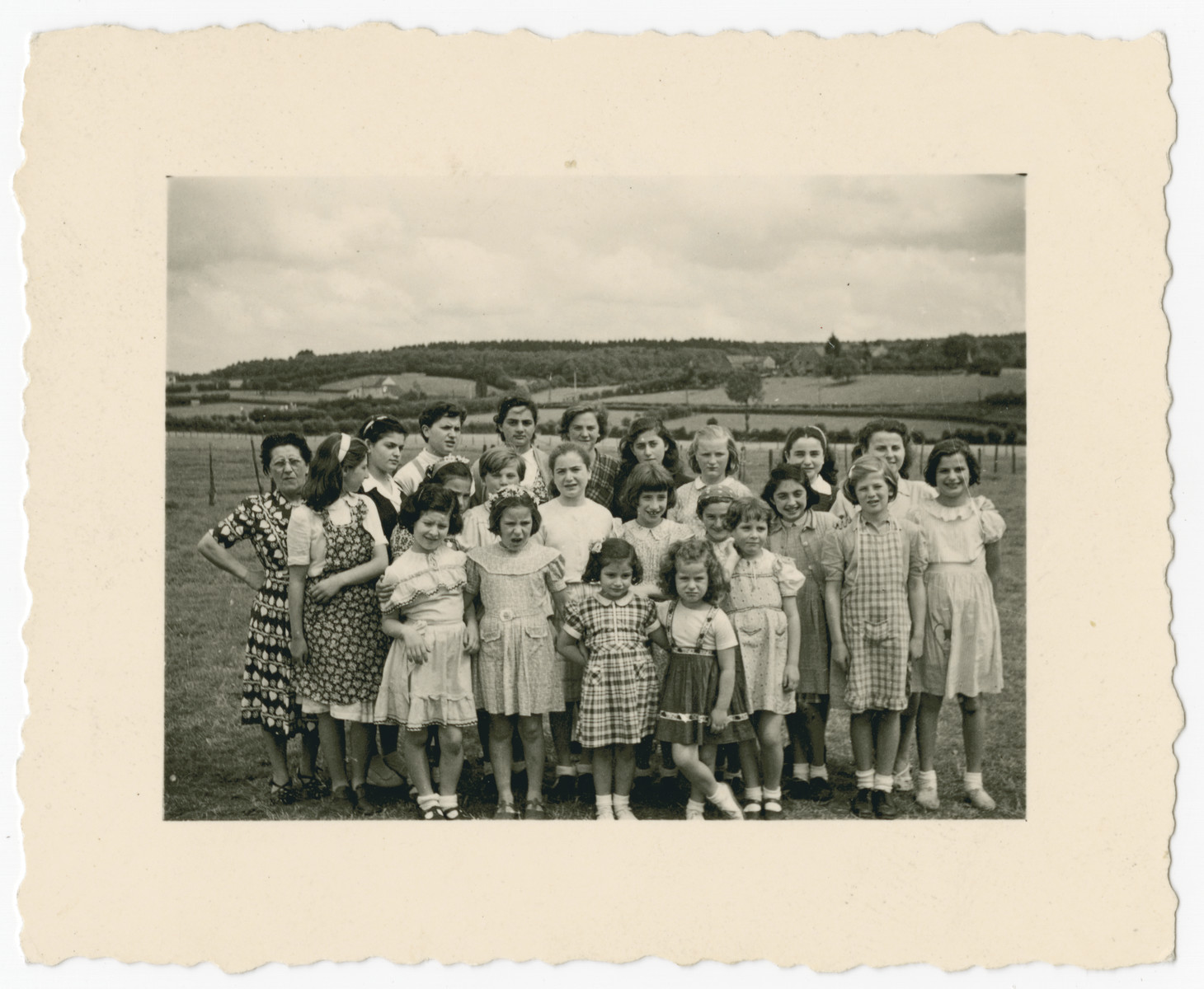 Girls from the Tiefenbrunner children's home pose while on an outing to the Belgian countyside.  In the back row center are Giselle and Berta.