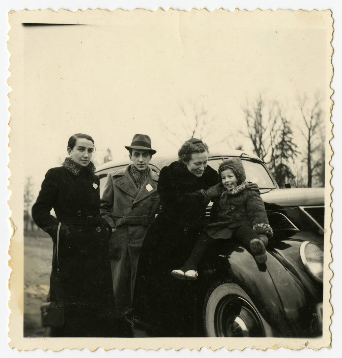Rosian Bagriansky sits on top of her father's Ford next to her mother and family friends.  Gerta Bagriansky is pictured second from the right next to her daughter Rosian.  Rivka Smukler Osherovitz is on the far left.
