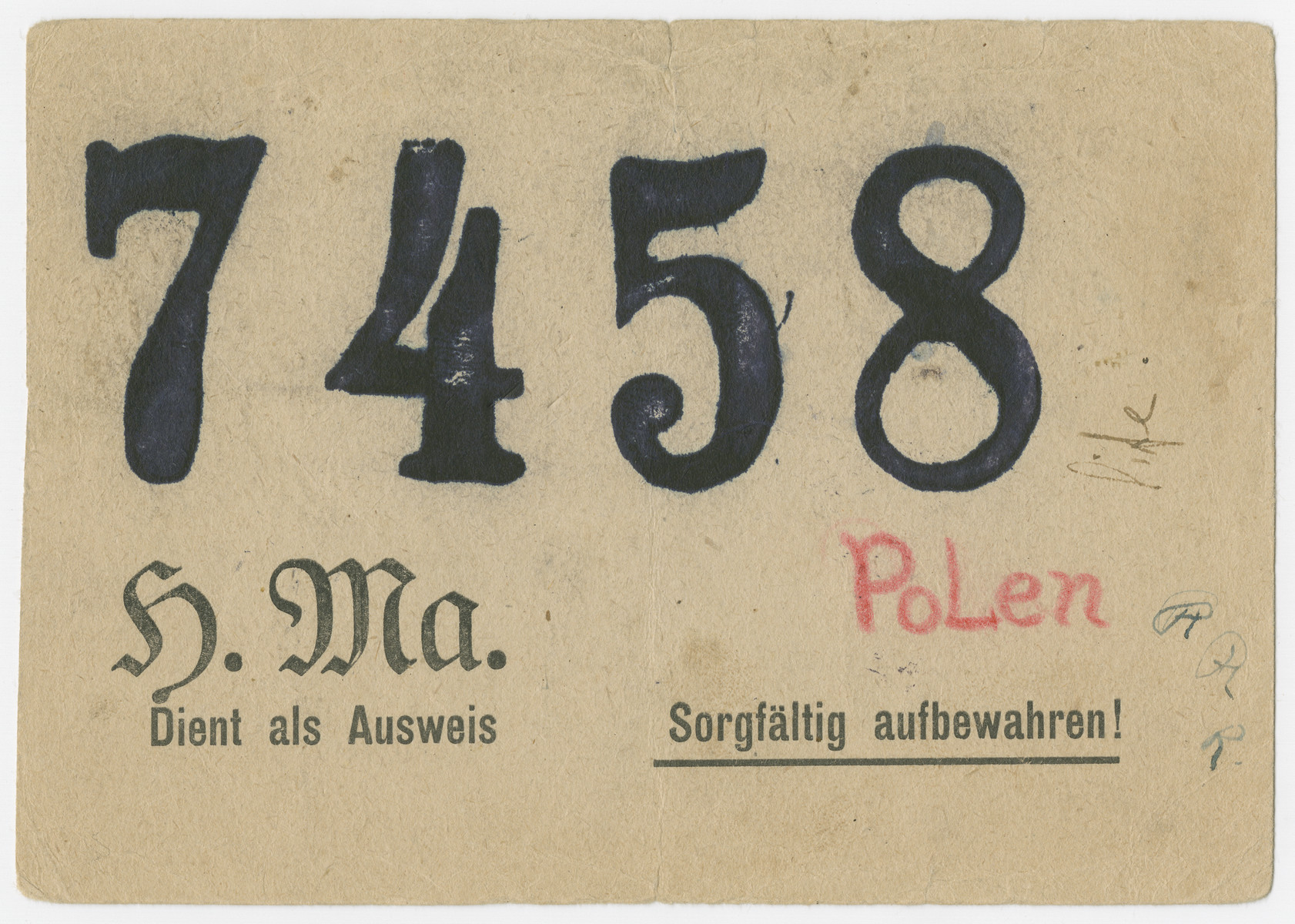 A temporary identification card issued to a Polish Jewish girl, Pola Fogelman, under a false name:  Pelagia Pisula.  The verso of the card has the prisoner number  7458.  The false last name is the name of her rescuer, Natalia Pisula.  The pass was used for Pola to get in and out of the Primerwald labor camp/munitions factory.