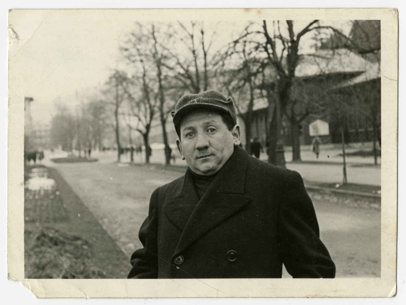 A member of the Rabinowitz family stands on a street in prewar Otwock..