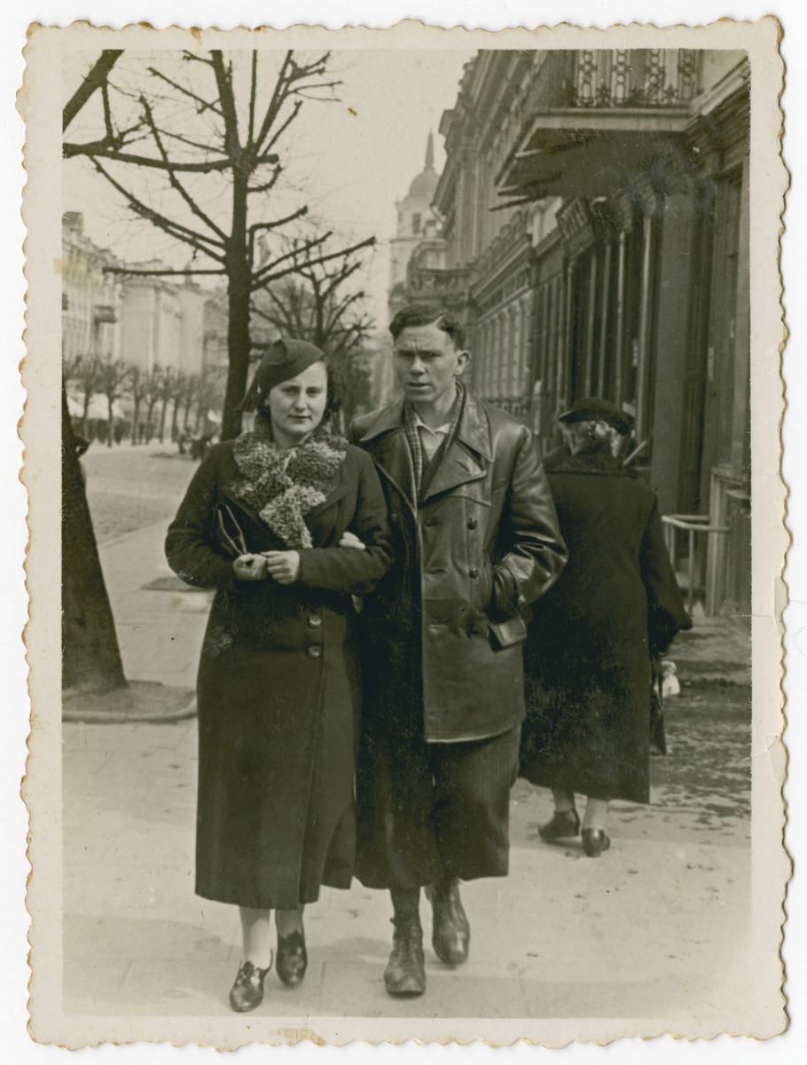"A Jewish couple walks down the street.  The inscription on the back of the photo reads, ""4/20/1936. Vilna"""