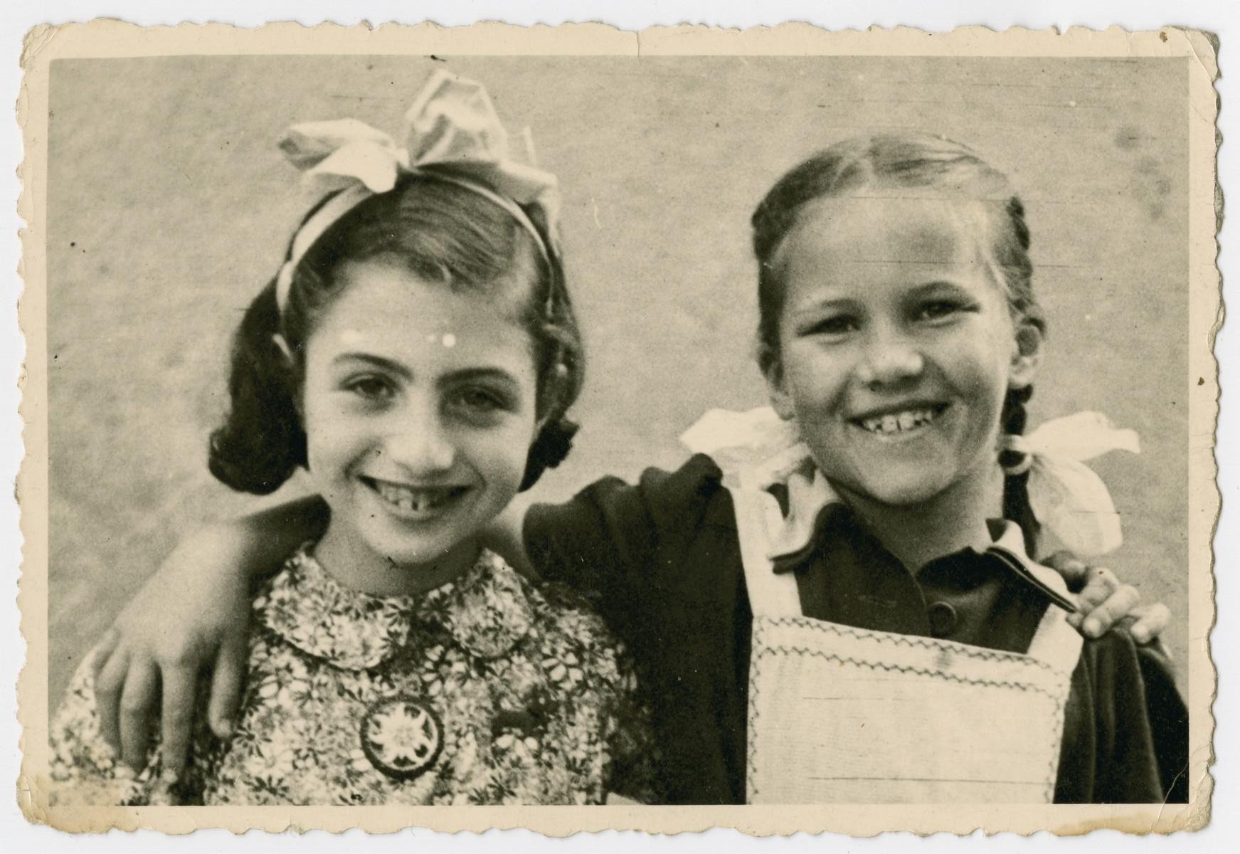 Eva Schonberg, a Jewish refugee child in Zurich, poses with her best friend Heidi.