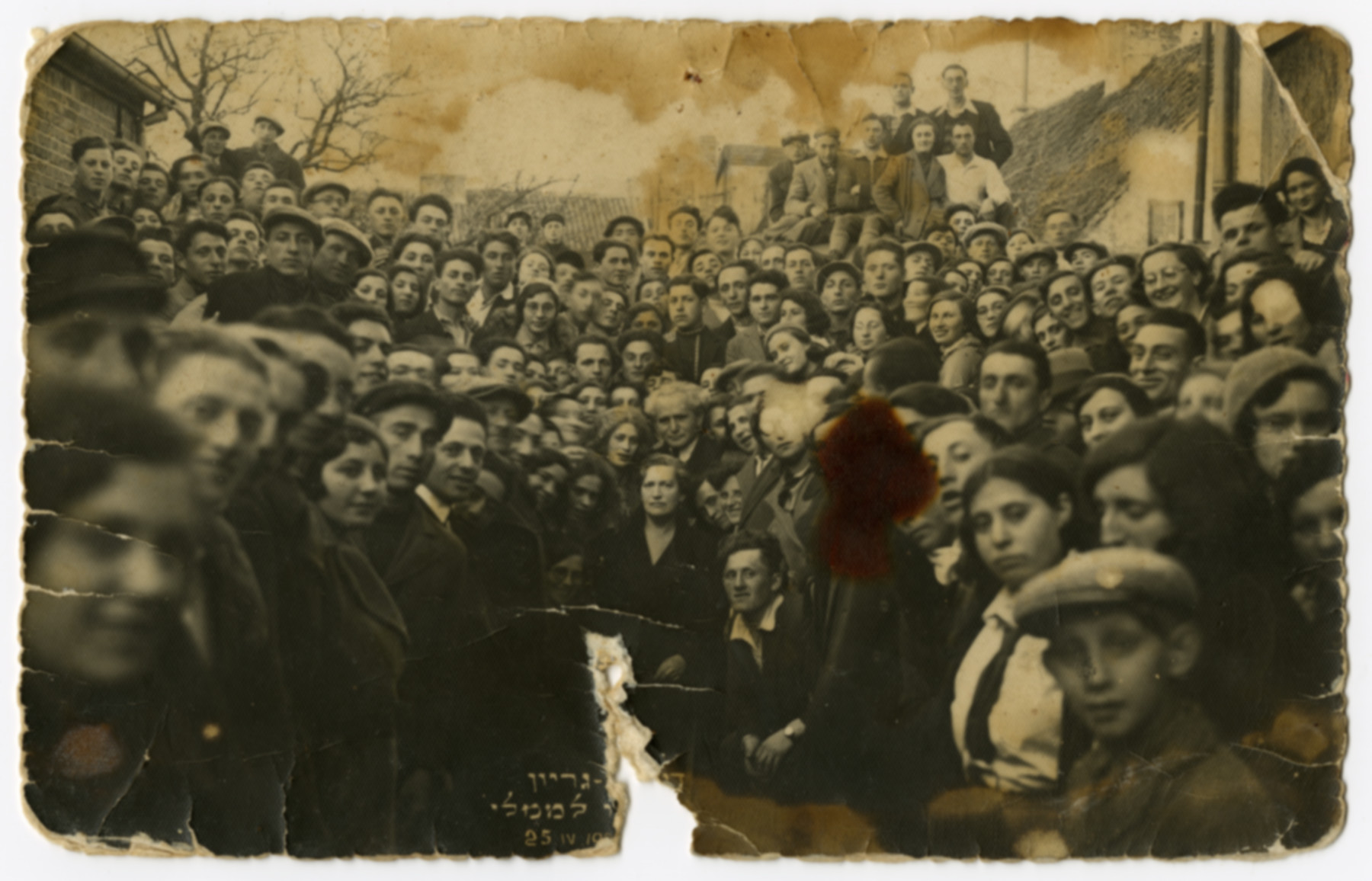 David Ben-Gurion visits Memel and is greeted by a large crowd.  Anna Chason is pictured in front of Ben-Gurion.