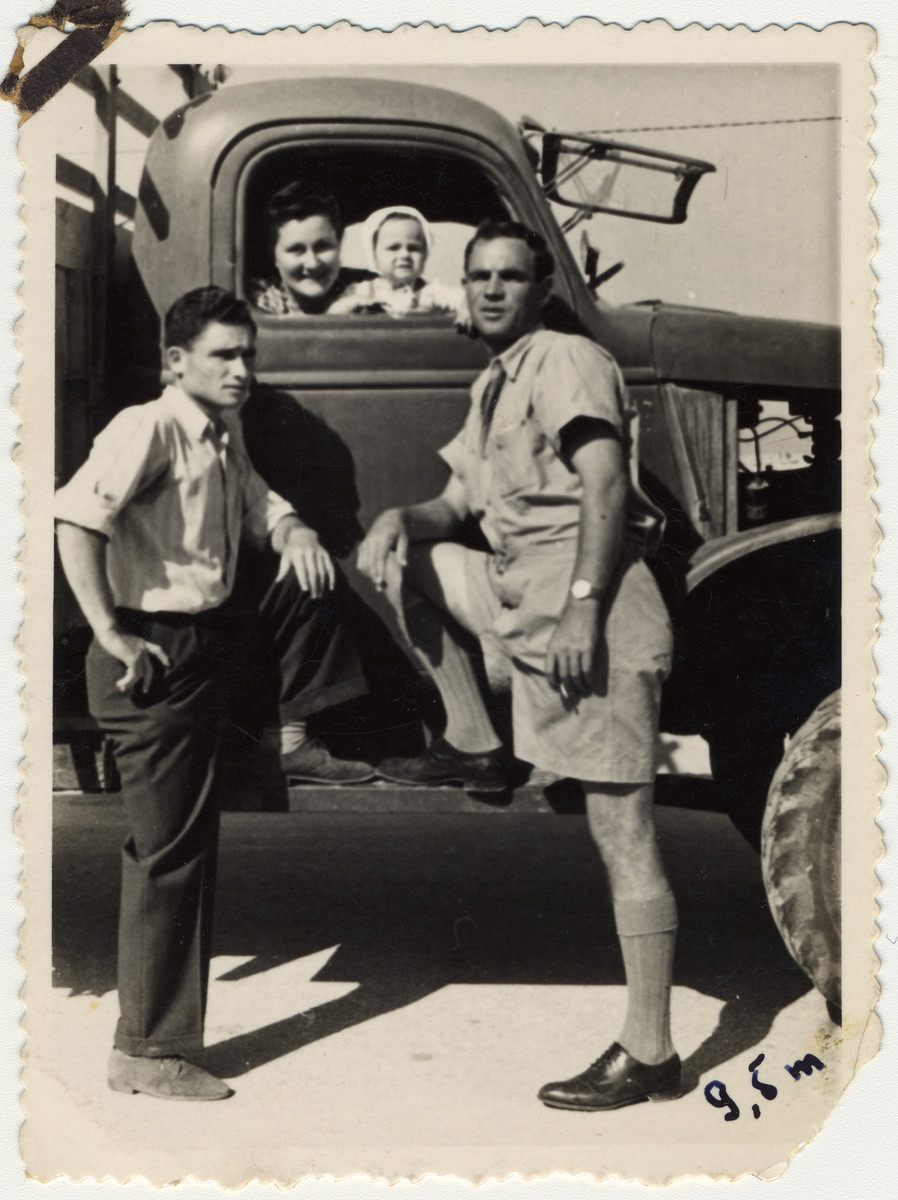 Partisan leader Zus Bielski stands next to his first truck with his wife, son and brother in postwar Israel.  Pictured left ot right are Aaron, Sonia, Yaakov and Zus Bielski.