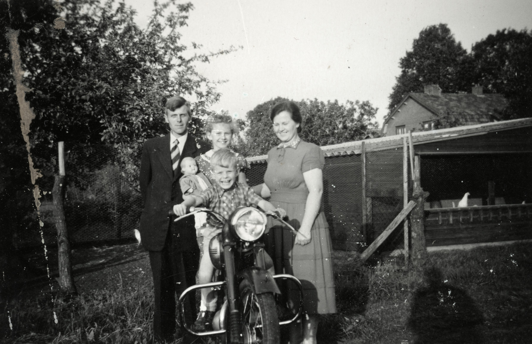 Dutch rescuers Reinier and Margaret Veerman play outside with their children on a motorcycle.  The Veermans hid the donor's brother Josef and were later recognized as Righteous Among the Nations.