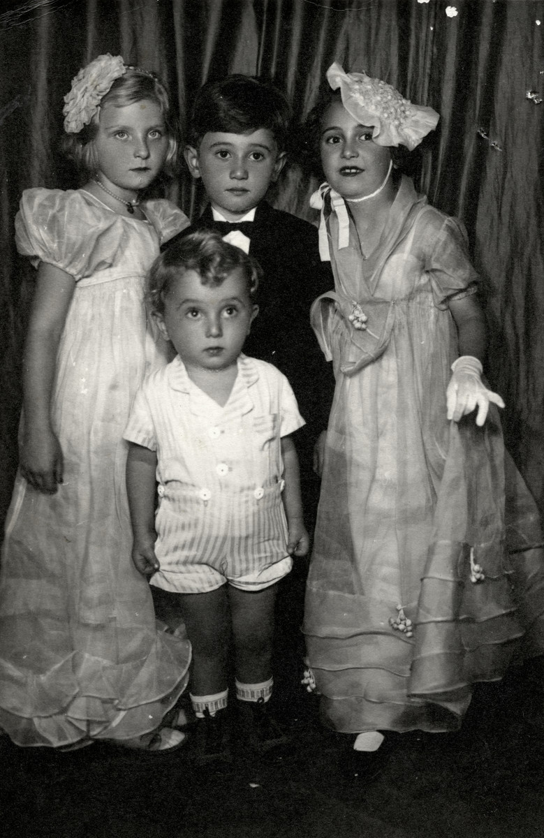 Young children attend the wedding of their Aunt Victoria.  Reine Behar (left) and Lena Charavon (right) are dressed as flower girls.  In the center are Lonnie Charavon (top) and Gaby Charavon (below).