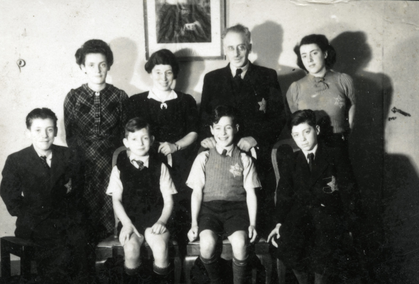 Wartime portrait of the Roet family taken shortly before the two daughters were deported and killed.   Seated from left to right are Josef, Haim, Aaron and Avraham Roet.  Standing are Adela, Johanna, Shlomo Pinchas and Rozinna Roet.