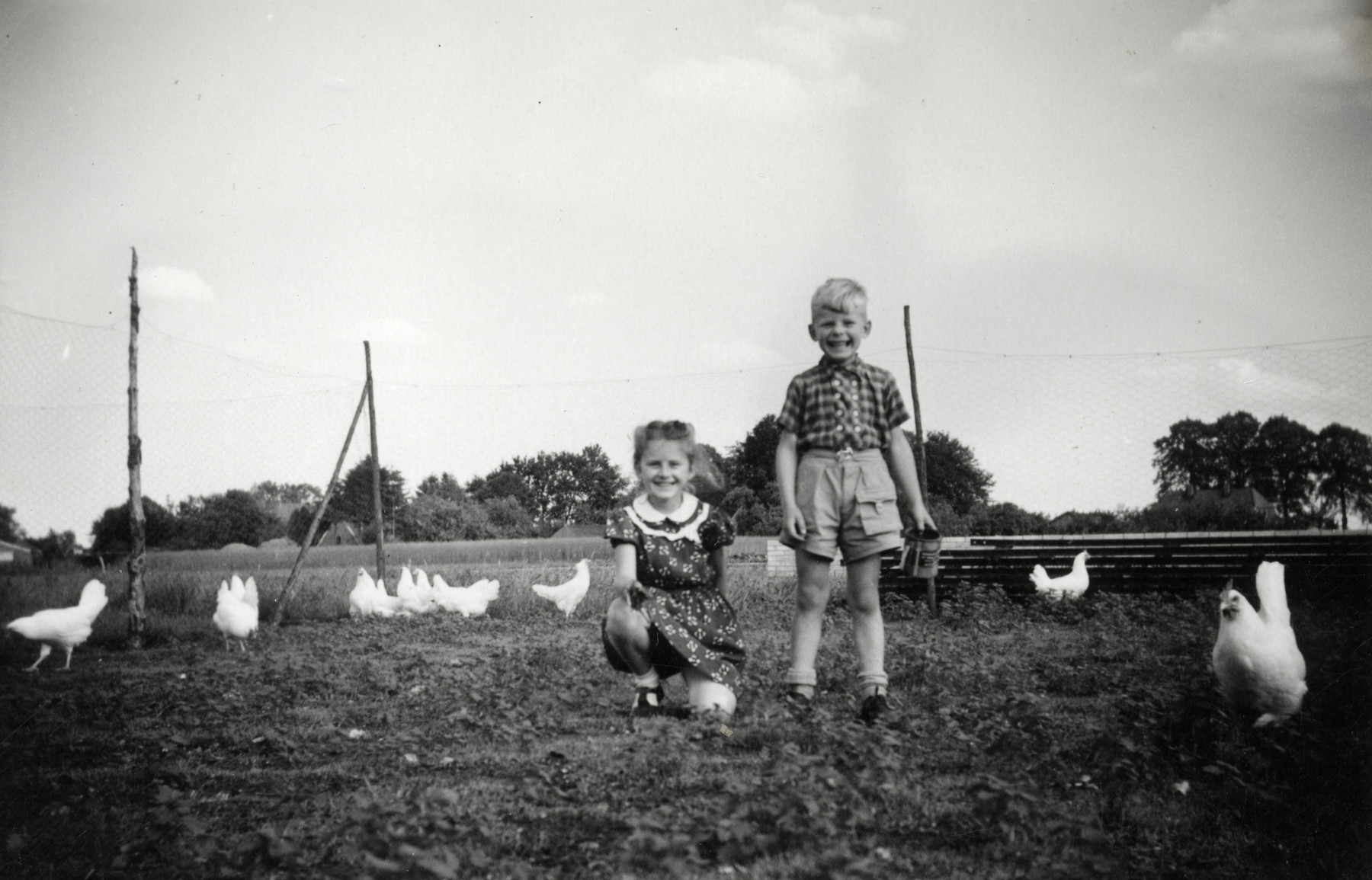 The children of rescuers Reinier and Margaret Veerman play outside among the chickens.