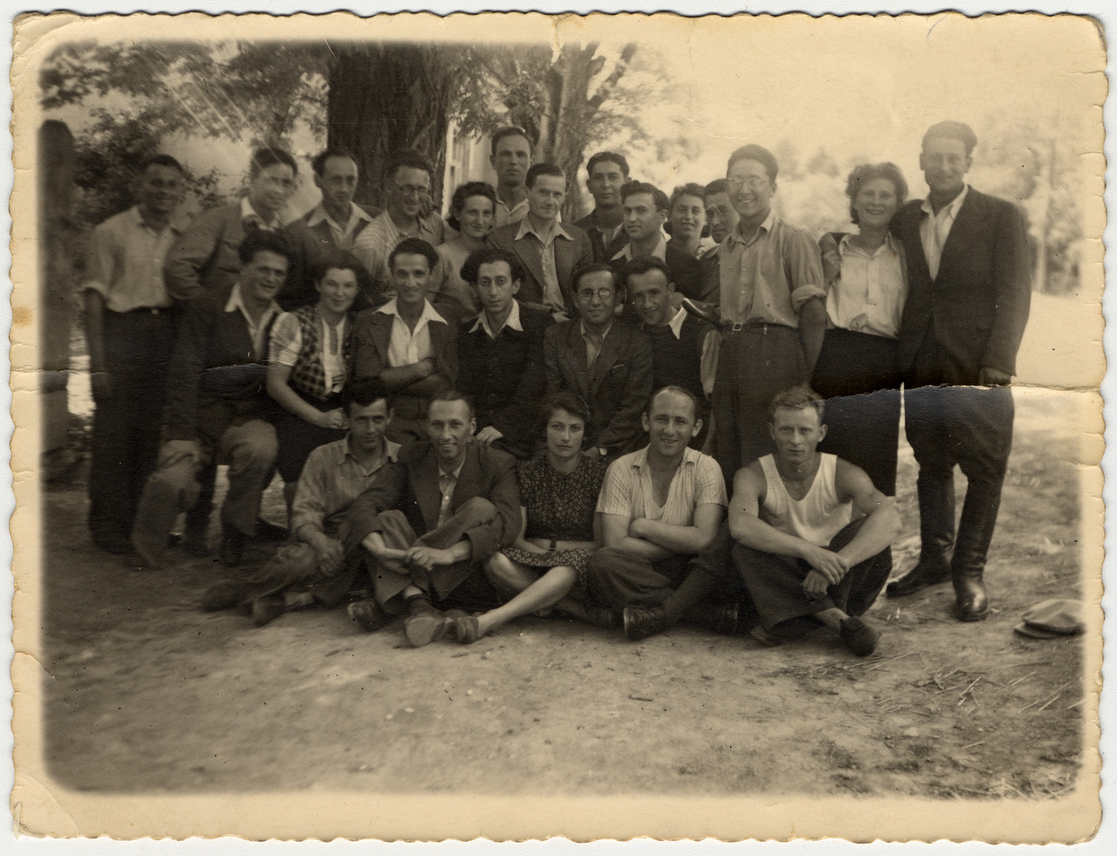 Former partisans from Belorussia and Lithuania gather for a reunion in Palestine.  Zus Bielski is in the back center.  Abba Kovner is seated in the center, second row.  His wife Vitka Kempner is behind him.  Shmerke Kaczerginsky is standing third from the left.