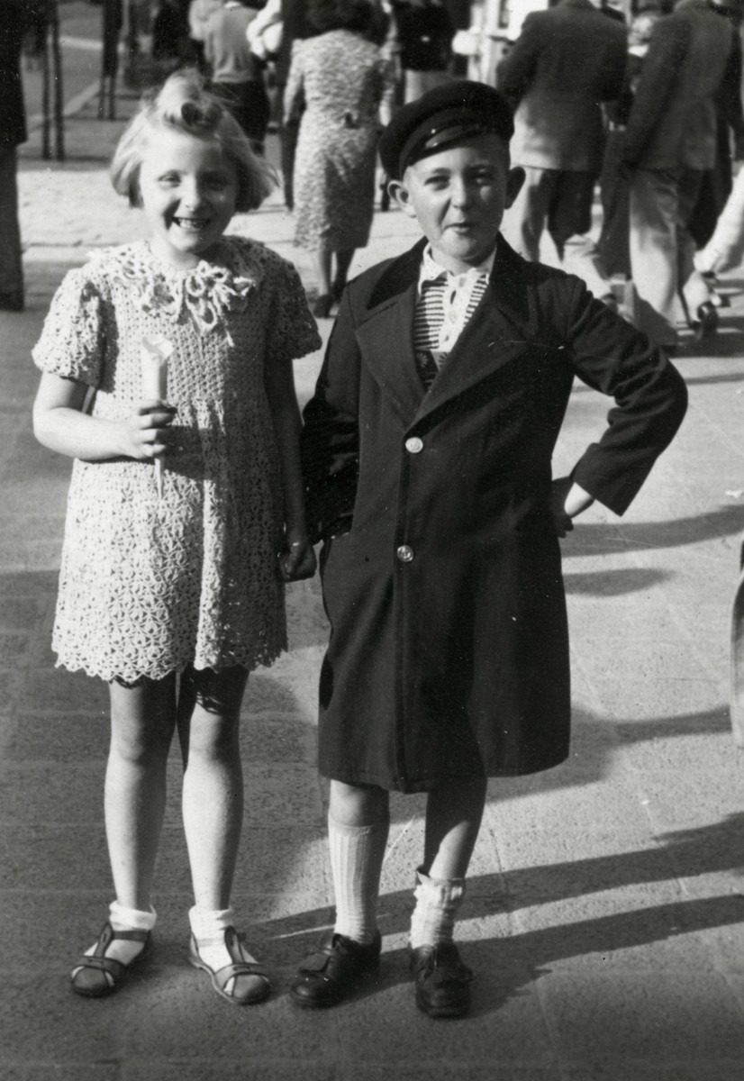 Reine Behar poses with her friend Boska Alvas on a street in Sofia.  She is wearing a dress that her mother made.