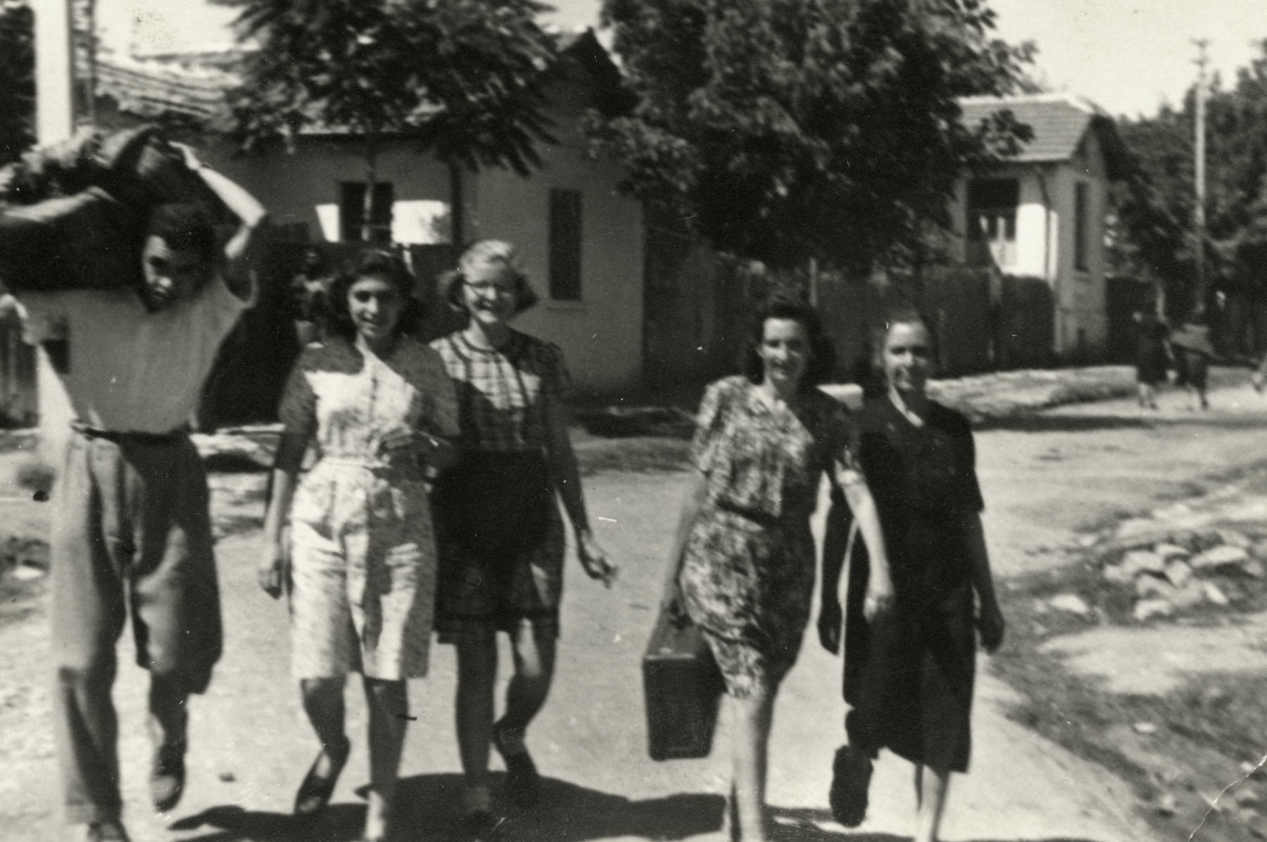 Friends greet two Communists who had been interned during the war.  Reine Behar is pictured third from the left.