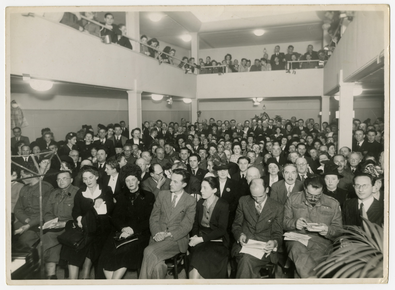 A large gathering of Belgian Jews gathers for a program for the Jewish Brigade.    Chaim Perelman is pictured in the front row, right.