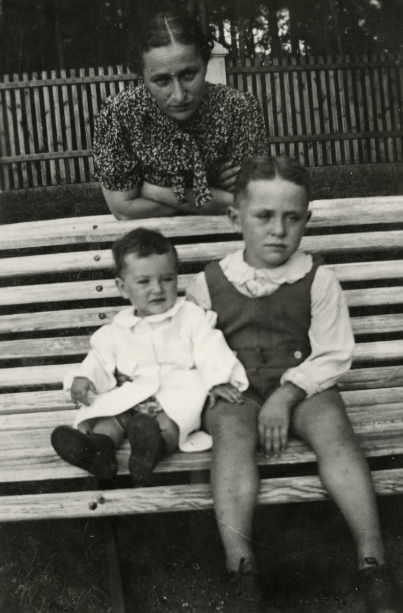 Leah Kaplan poses with her two children, Shalom and Yehudit, on a park bench in prewar Kaunas.