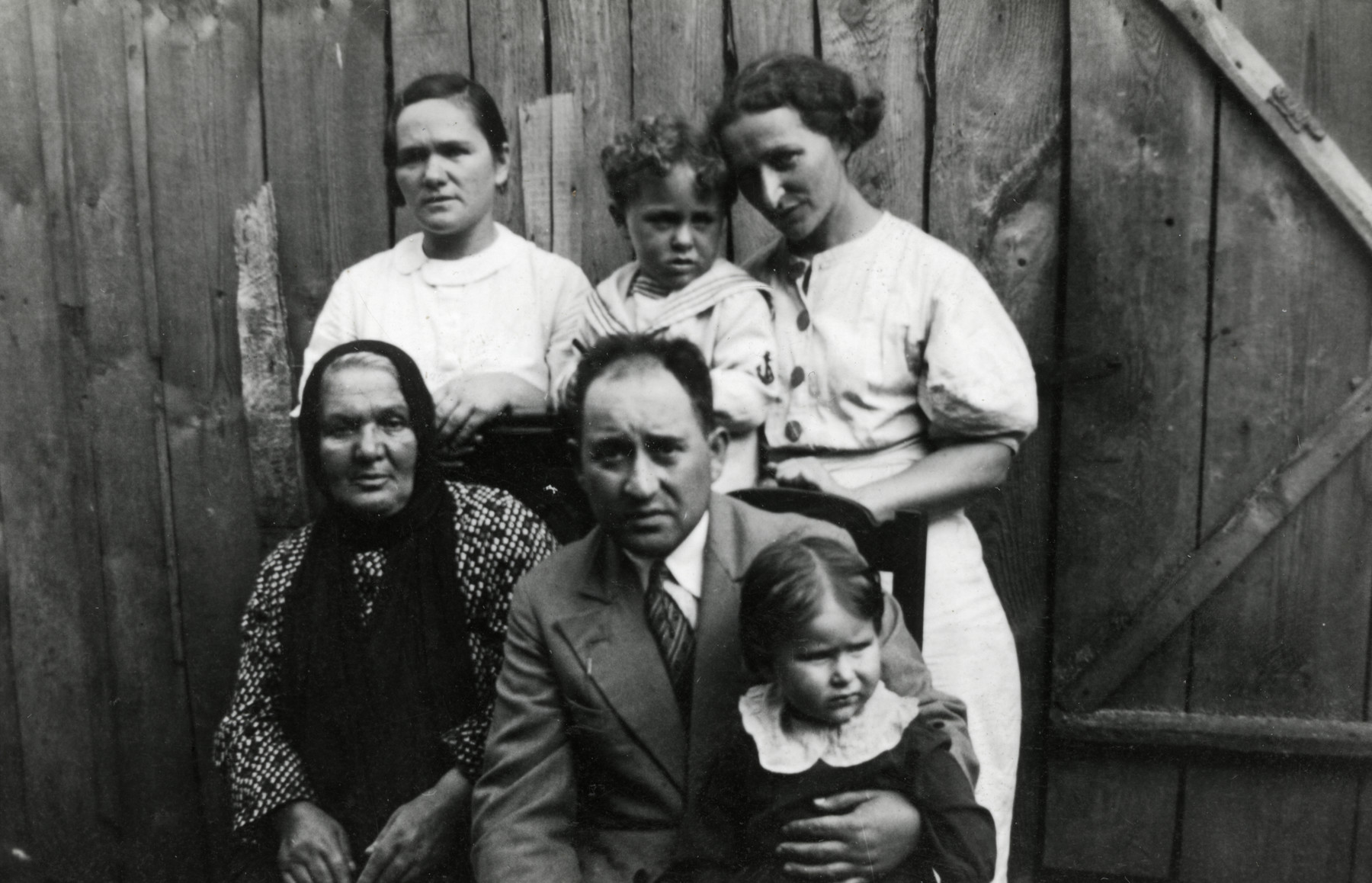Prewar portrait of an extended Lithuanian Jewish family.  Seated from left to right are Bella Kaplan (grandmother of the donor), Shmuel Siderer (uncle) and his daughter Rivke.  Standing are Liba Siderer (sister of Israel Kaplan), Shalom Kaplan (the donor) and Leah Kaplan.  Other than the donor, everyone else perished.