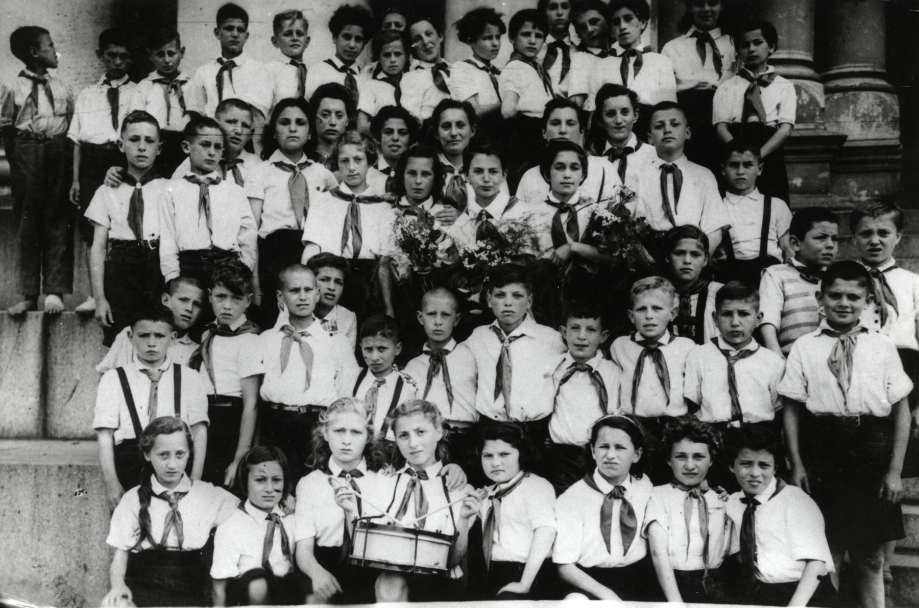 Group portrait of a postwar Jewish orphanage in Kaunas with Communist leanings.  Shalom Kaplan is pictured in the third row from the bottom.