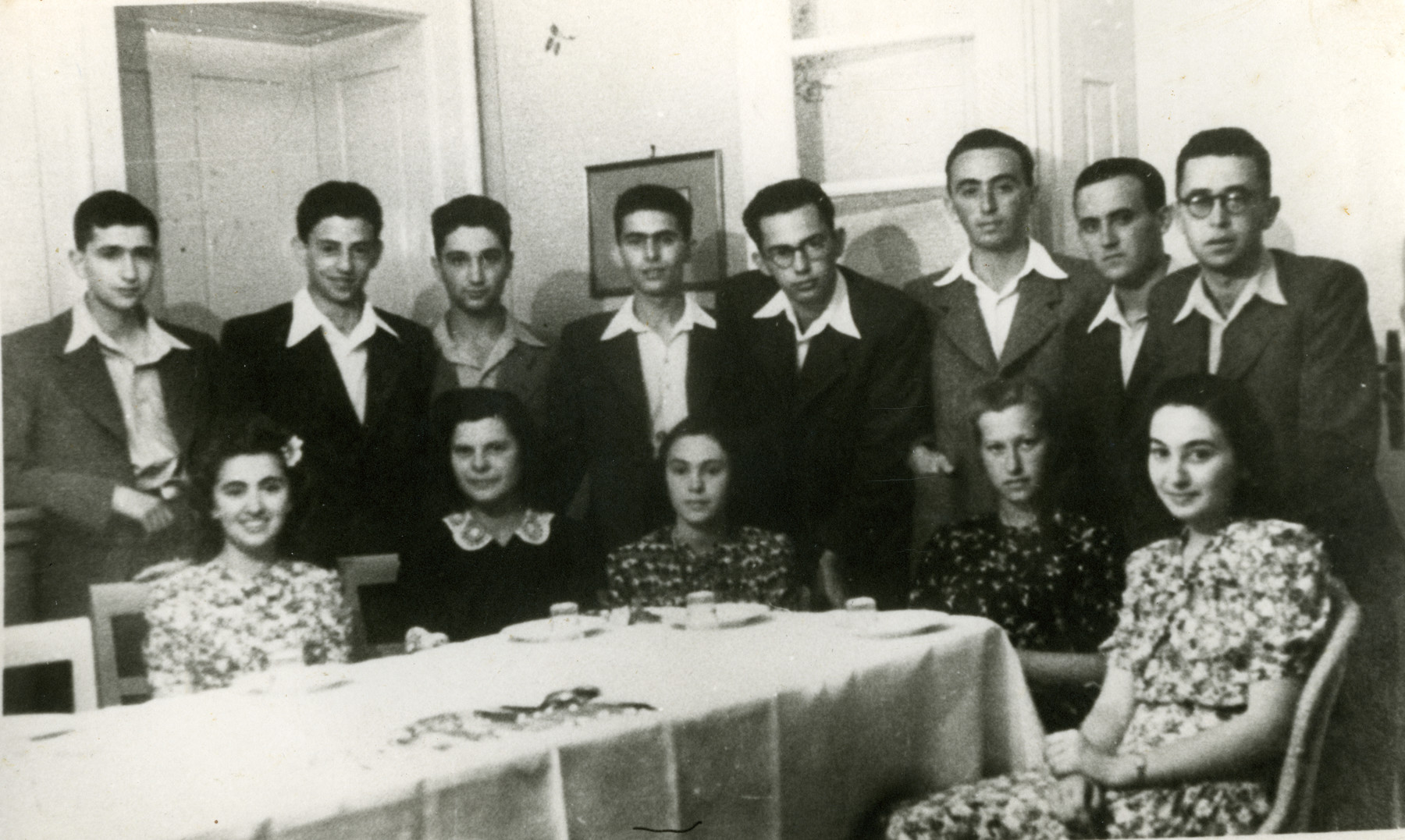 Jewish students celebrate their graduation though they officially had been expelled from school.  Yehudit Steiglitz is the third girl from the right.