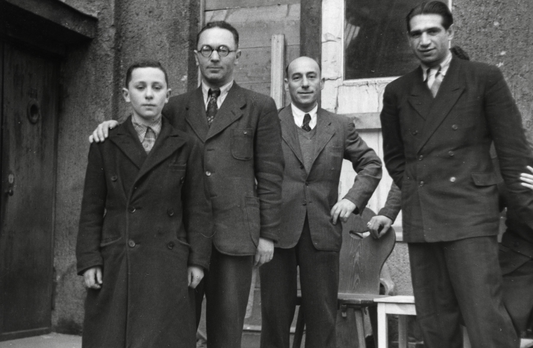 Shalom Kaplan poses with his father and other staff from the Unzer Weg newspaper.