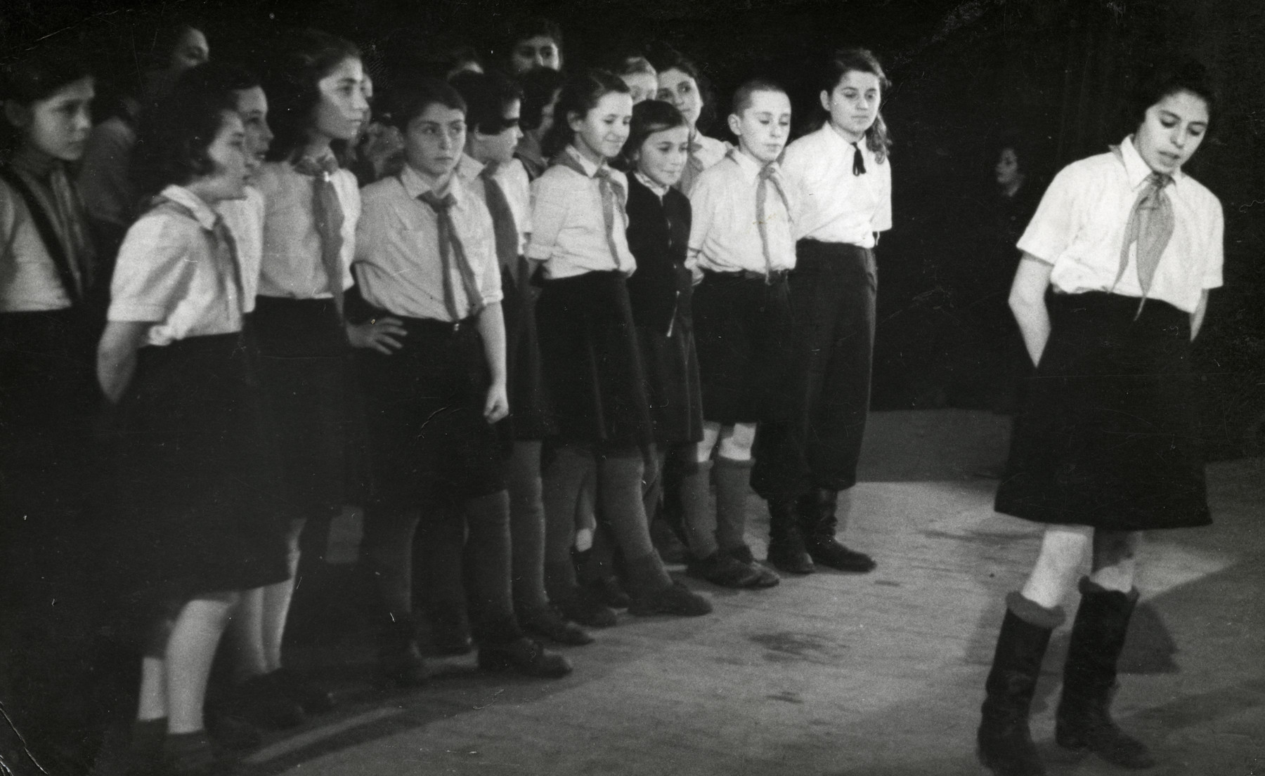 Group portrait of a postwar Jewish orphanage in Kaunas with Communist leanings.  Shalom Kaplan is pictured third from the right.