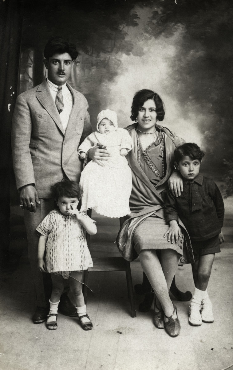 Prewar studio portrait of the Tayar family.  Pictured left to right are Daniel Tayar, Rene, Roger (baby), Simcha and Raoul.