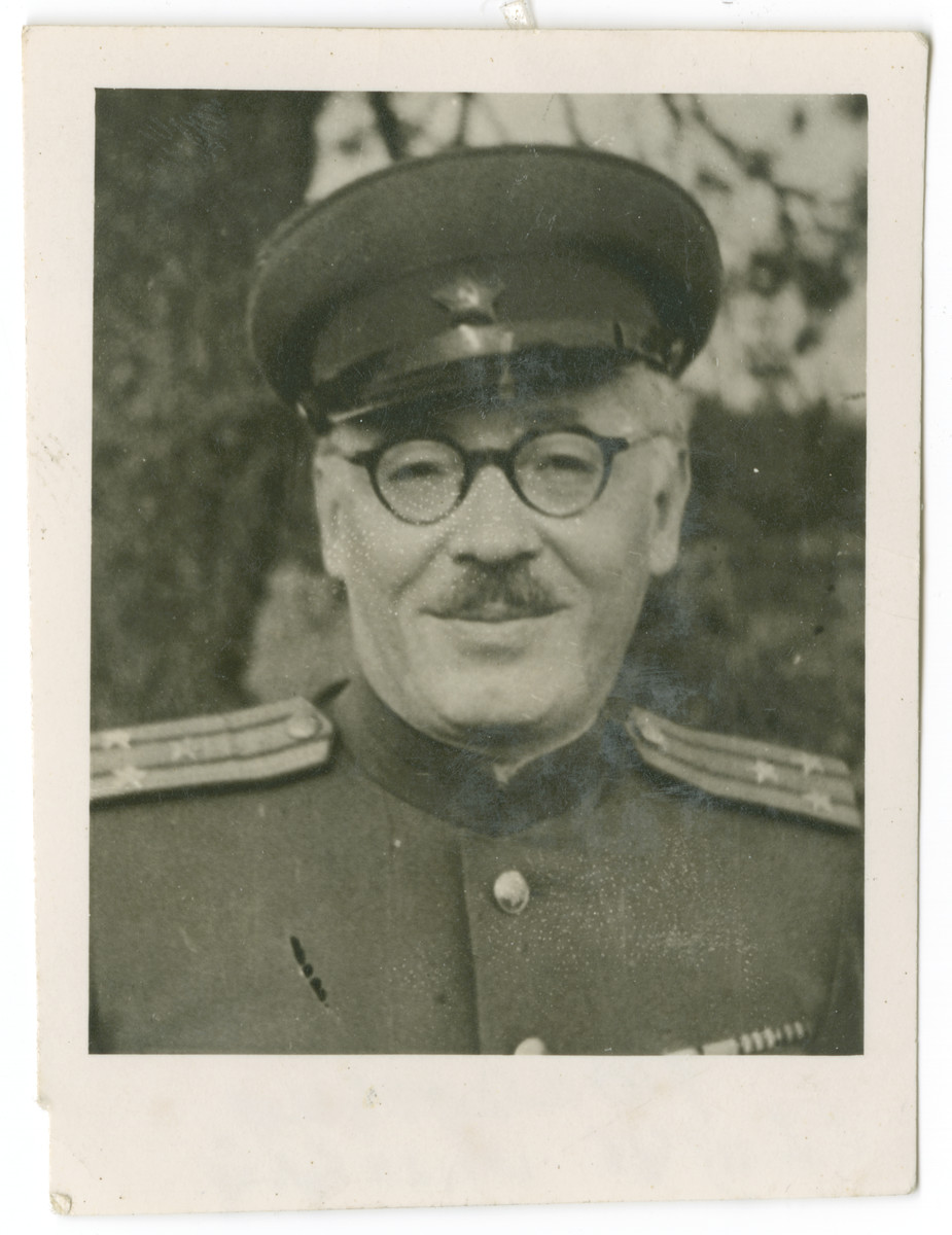 "Head shot of a Soviet colonel working in the International Miilitary Tribunal in Nuremberg.  The original caption reads: ""To remind you of our common efforts in the I.M.T. with friendly greetings."""