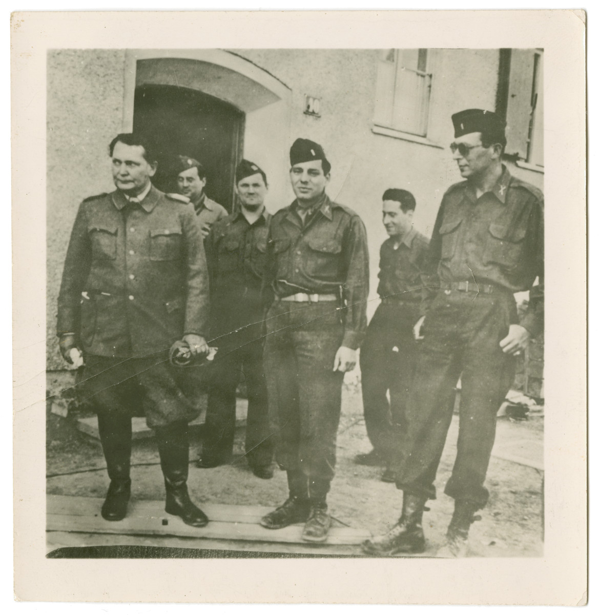 American soldiers surround Hermann Goering after his arrest [or possibly outside the Nuremberg tribunal].   Rolf Wartenberg is pictured in the center.