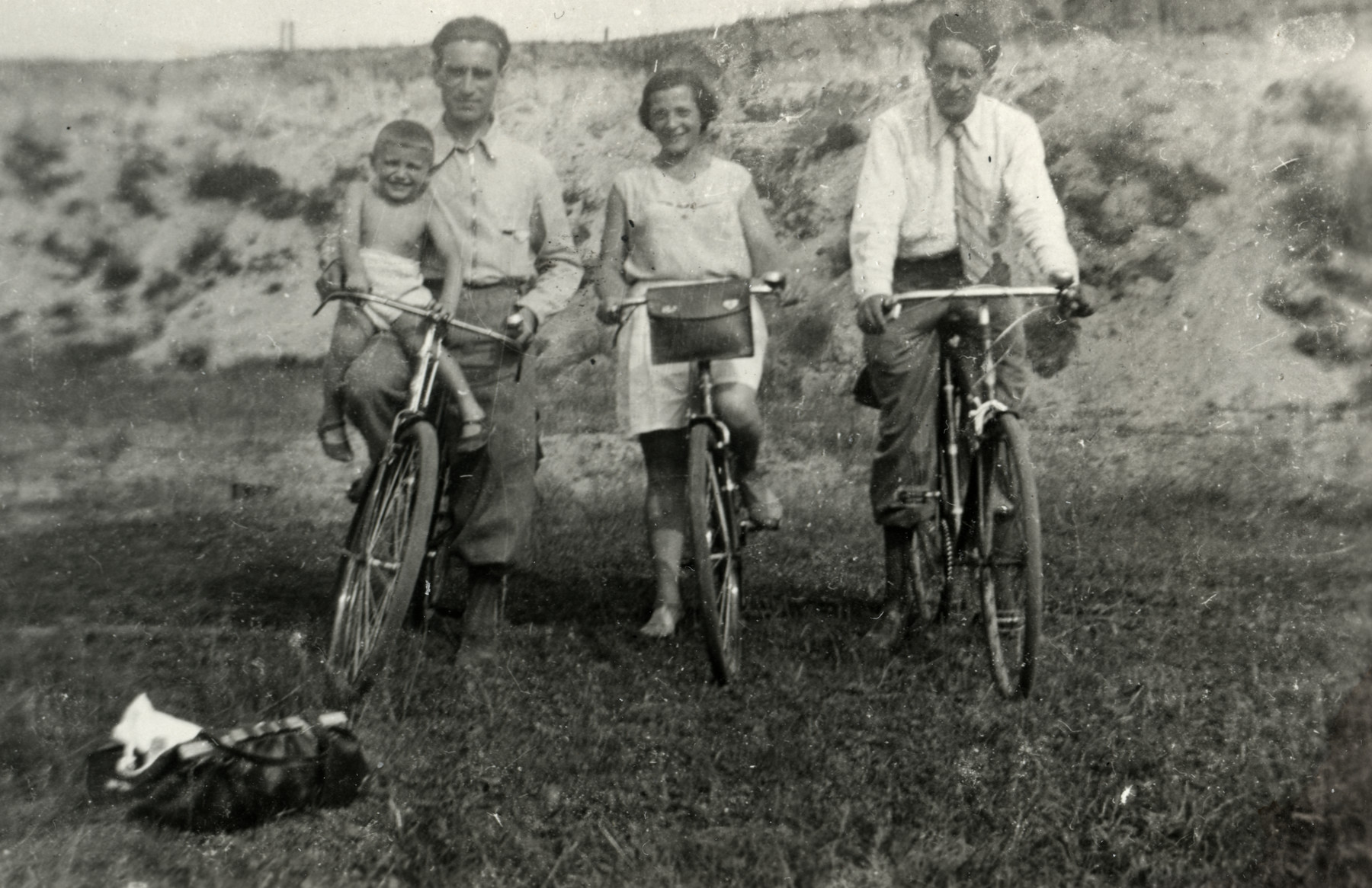 Michel Werber rides on the handlebars of his father's bicycle accompanied by his aunt and uncle.    From left to right are Michel and Abush Werber, Paulina and Dode Troki.